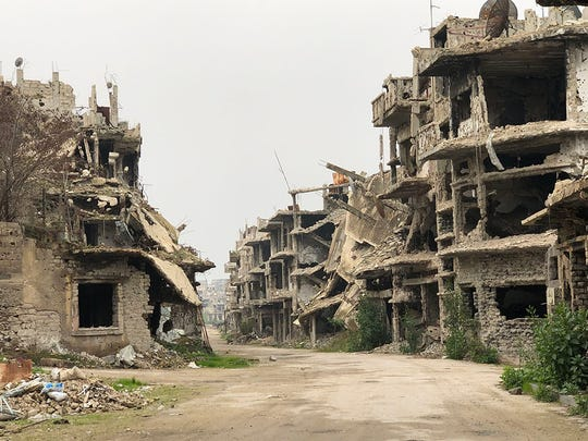 The devastation of a neighborhood in Homs, Syria, where Dr. Souheil Saba owned a home for his wife's family to live. Saba, a retired gynecologist, closed his Clifton practice last year to open a medical school in his home country of Syria.