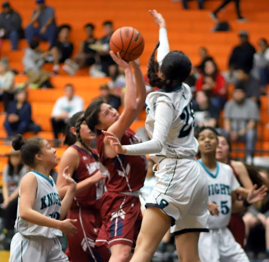 Senior Adriana Giron worked hard in the paint for 22 points to lead all Lady 'Cats players in Monday's 56-50 loss at Onate High School.