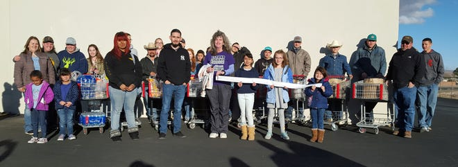 Luna County 4-H members clogged up the wide aisles of Peppers Supermarket on their annual shopping spree for the Healing House, Luna County's shelter for victims of domestic violence. The members donated over $1,200 in groceries and supplies for the residents of the Healing House.