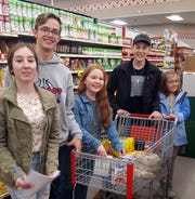 Luna County 4-H members filled shopping carts at Peppers Supermarket on Feb. 19 to help out the Healing House, Luna County's shelter for victims of domestic violence.