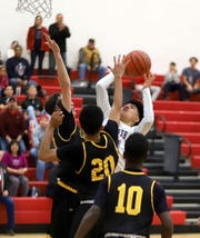 """Sophomore Wildcat post Christian Pahceco called his teammates 'dangerous"""" heading into the post season."""