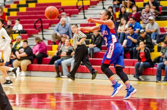 Las Cruces High Senior Alexia Gonzales passes the ball during the No. 6-seed Bulldawgs' upset at No. 3 Centennial 44-39 in the first round of the District 3-5A Tournament on Monday, Feb. 25, 2019.