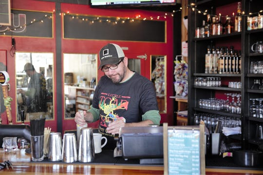Employee Michael Layton adds Irish cream to a cup of coffee at Little Toad Creek Brewery and Distillery in downtown Las Cruces. The tasting room now serves coffee roasted by Picacho Coffee.