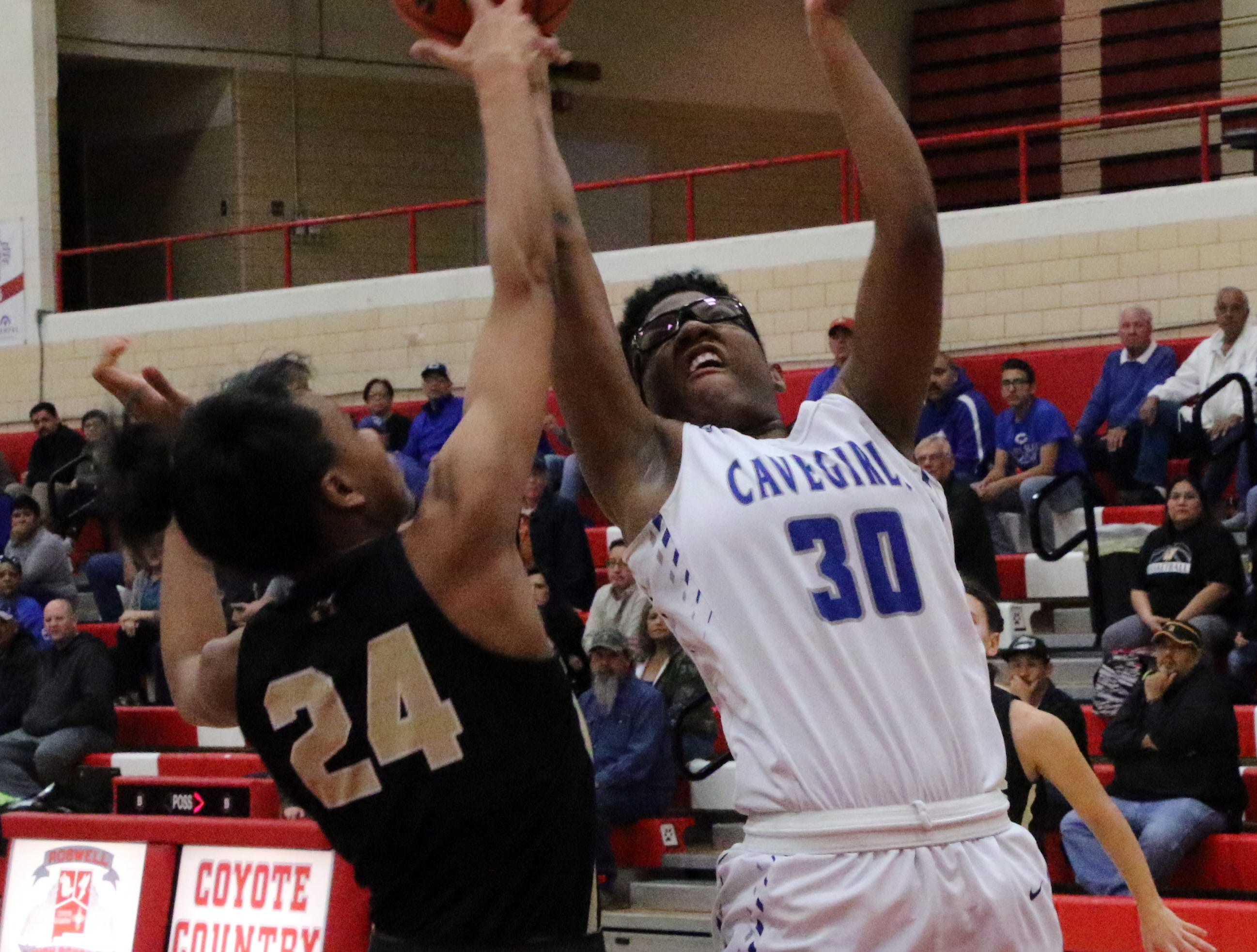 Dayshaun Moore is fouled while taking a contested shot during Monday's one-game playoff to determine the No. 1 team in Class 4-5A.