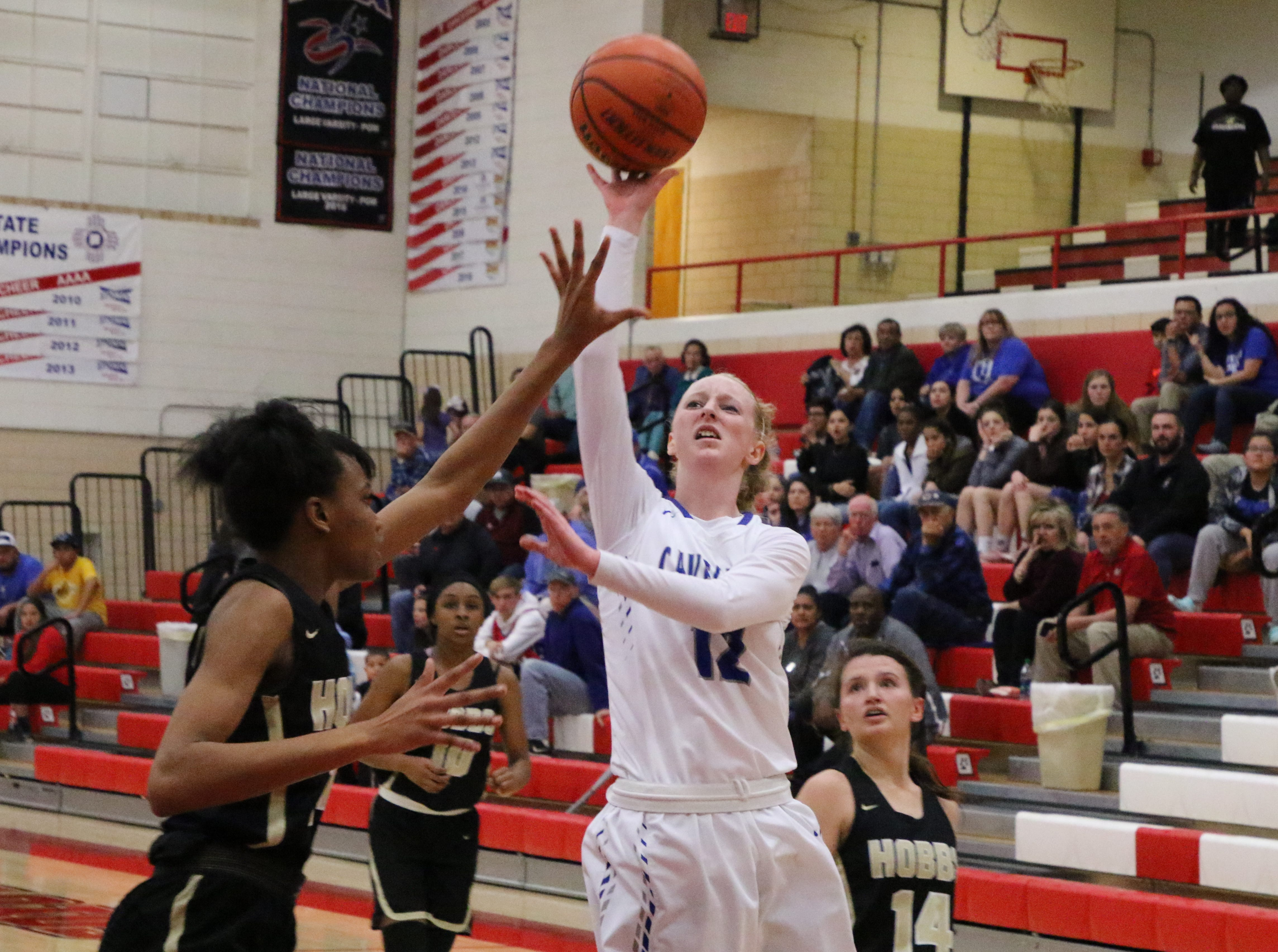 Carsyn Boswell gets off a contested shot in the fourth quarter of Monday's one-game playoff to determine the No. 1 team in Class 4-5A.