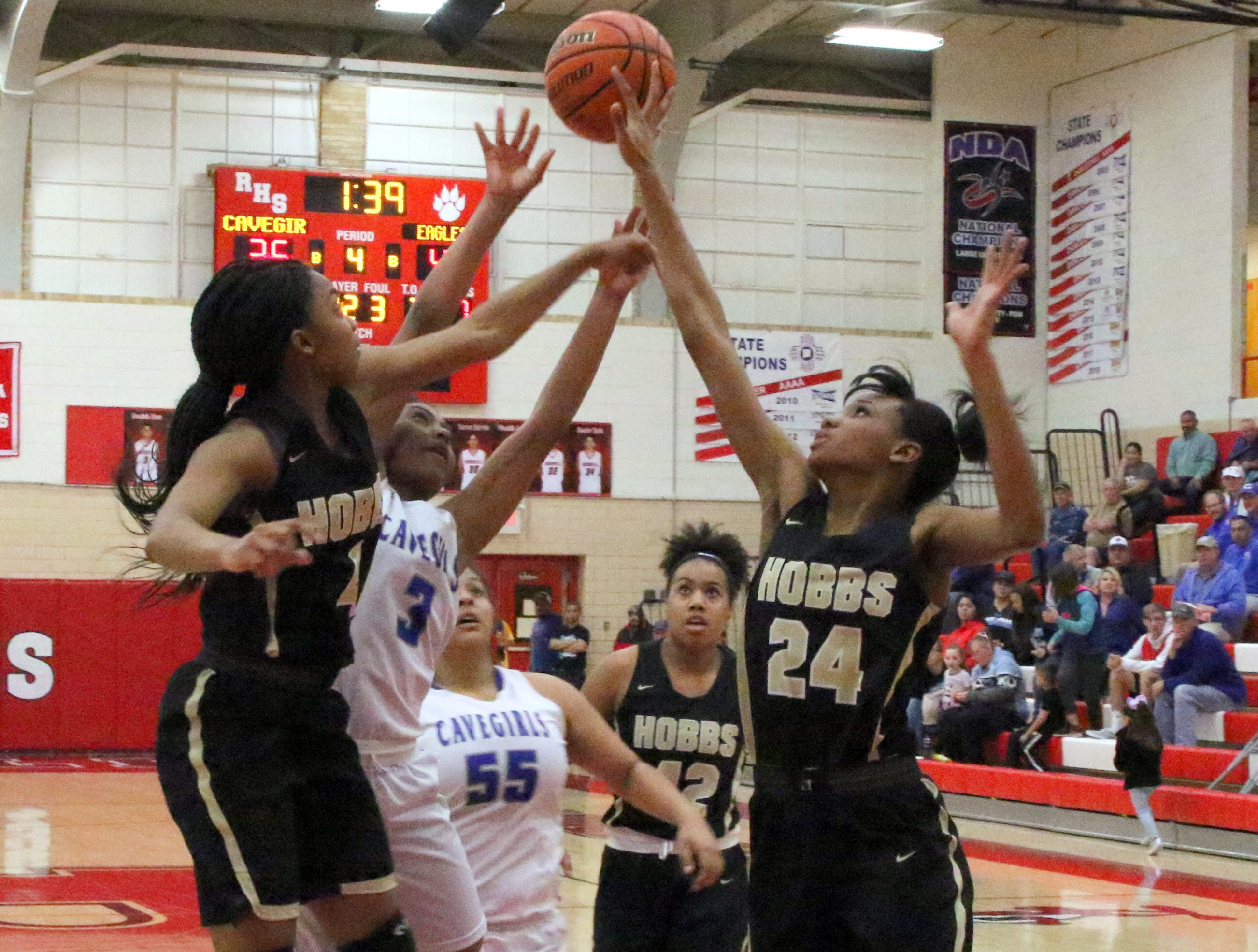 Destiny Young is fouled attempting a layup during Monday's one-game playoff to determine the No. 1 team in Class 4-5A.