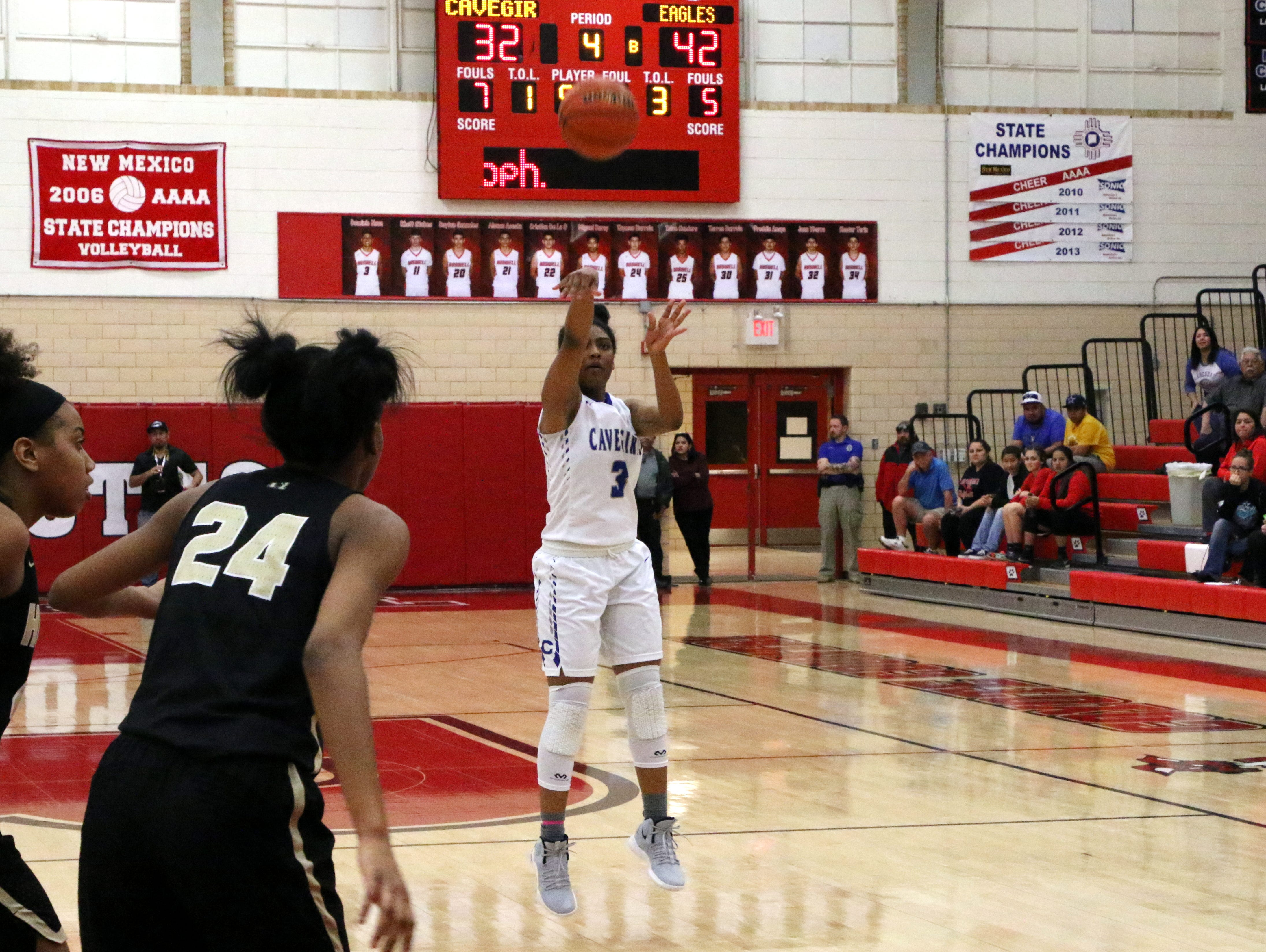 Destiny Young takes a 3-point shot in the fourth quarter of during Monday's one-game playoff against Hobbs to determine the No. 1 team in Class 4-5A.