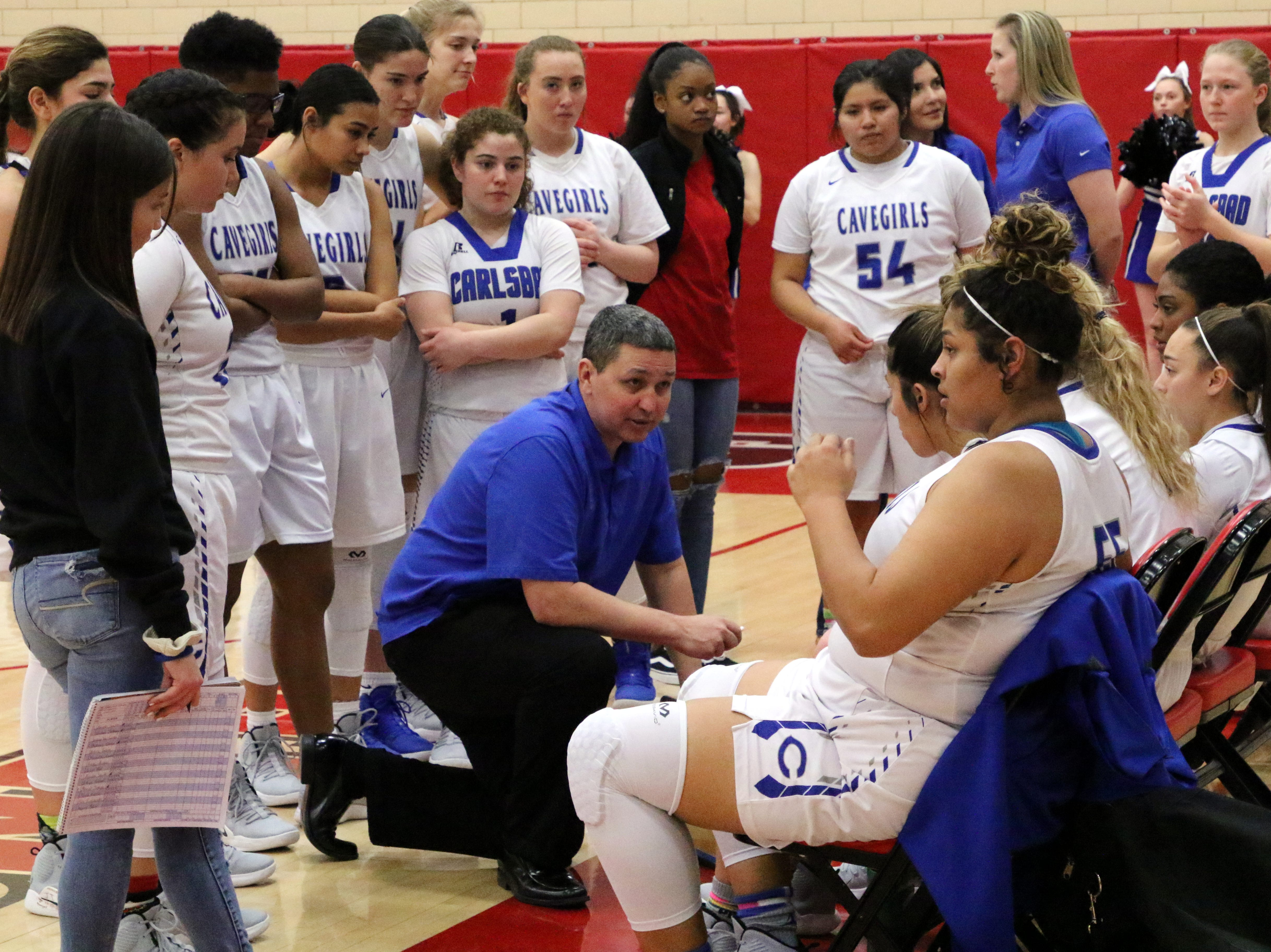 Carlsbad's John Zumbrun talks to his team during a timeout in Monday's one-game playoff to determine the No. 1 team in Class 4-5A.