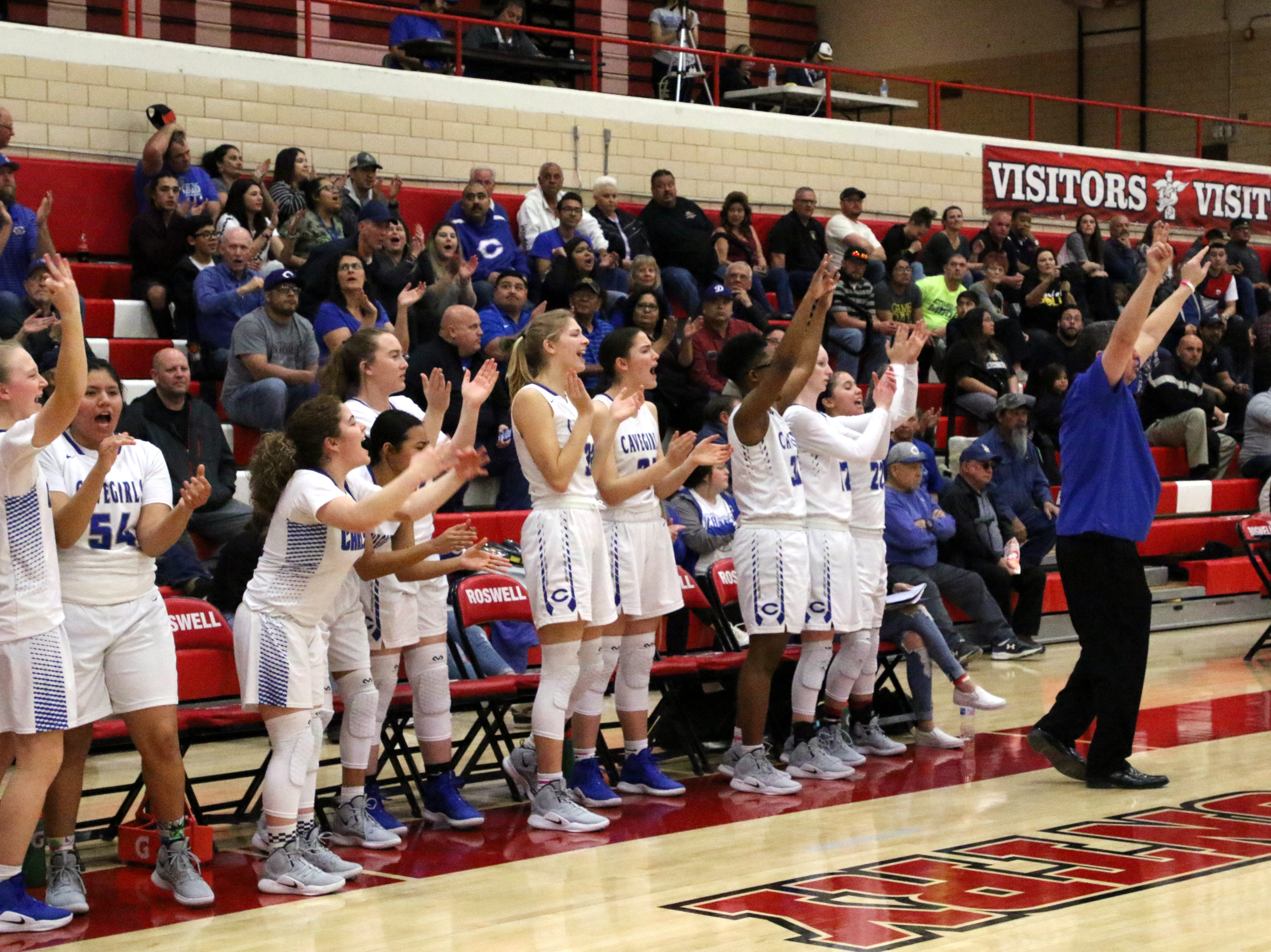 Carlsbad's bench erupts after a made 3-pointer during Monday's one-game playoff to determine the No. 1 team in Class 4-5A.