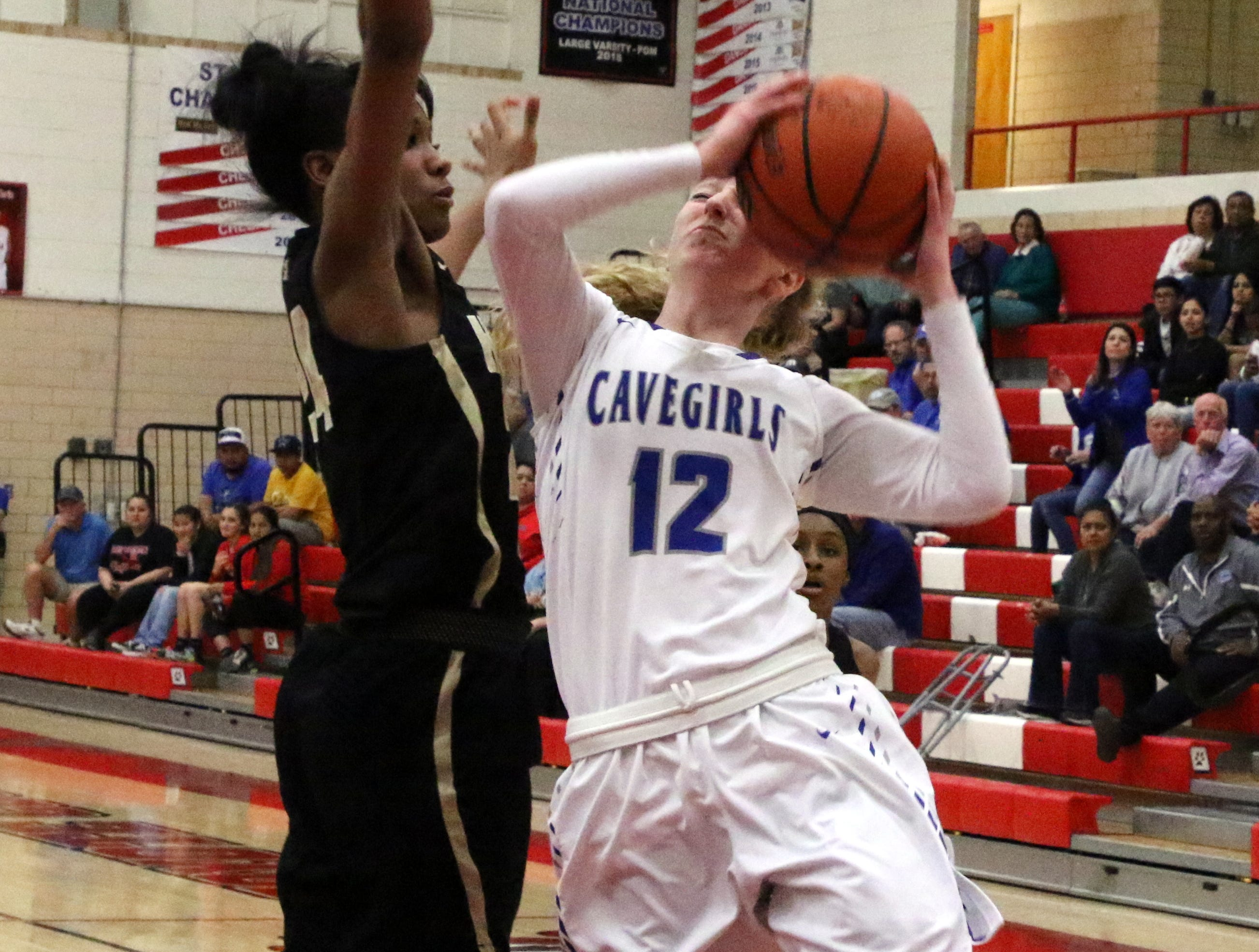 Carsyn Boswell is fouled while attempting a layup in the first quarter of Monday's one-game playoff against Hobbs to determine the No. 1 team in Class 4-5A. She finished with nine points.