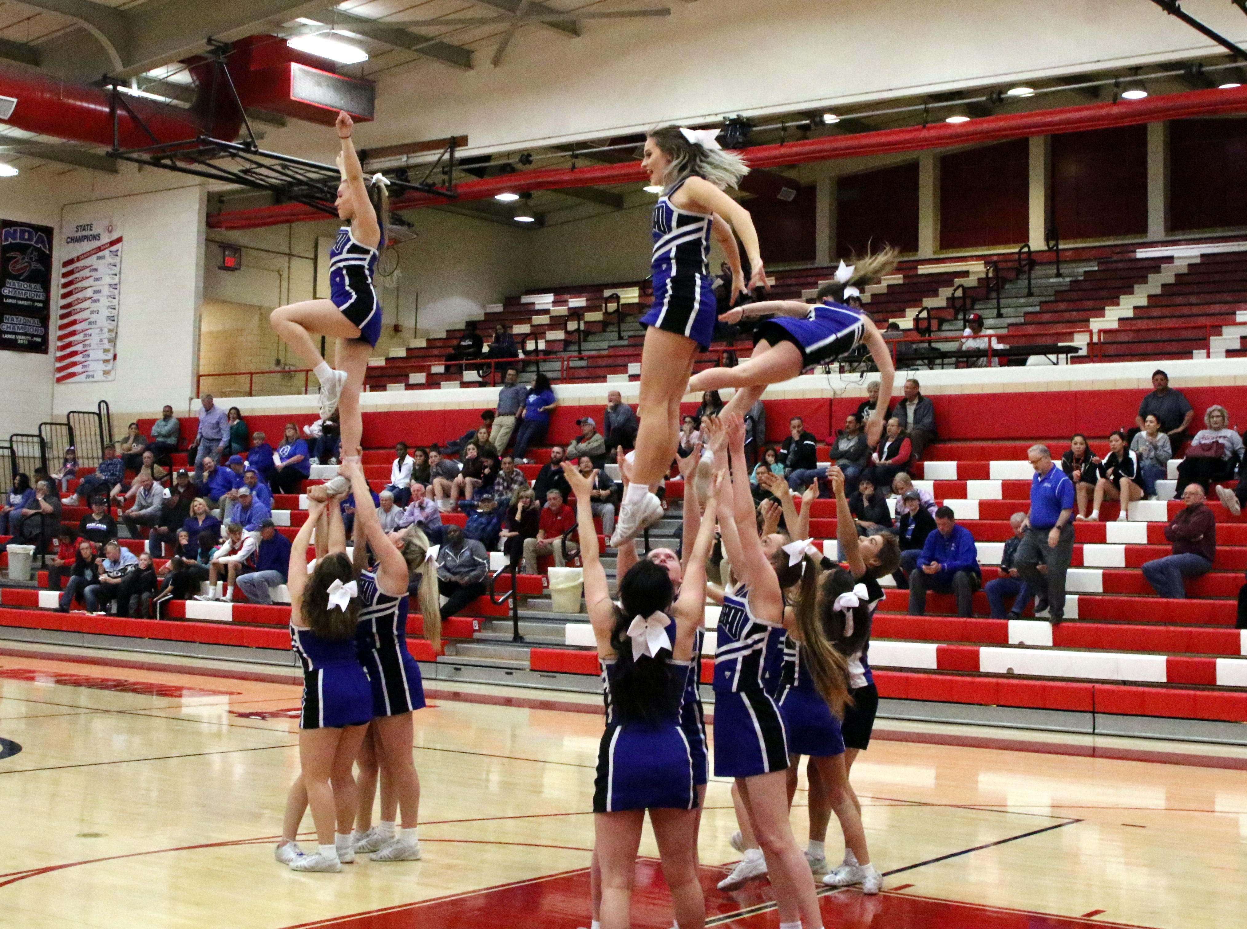 Carlsbad's cheerleaders complete a routine during Monday's game against Hobbs.