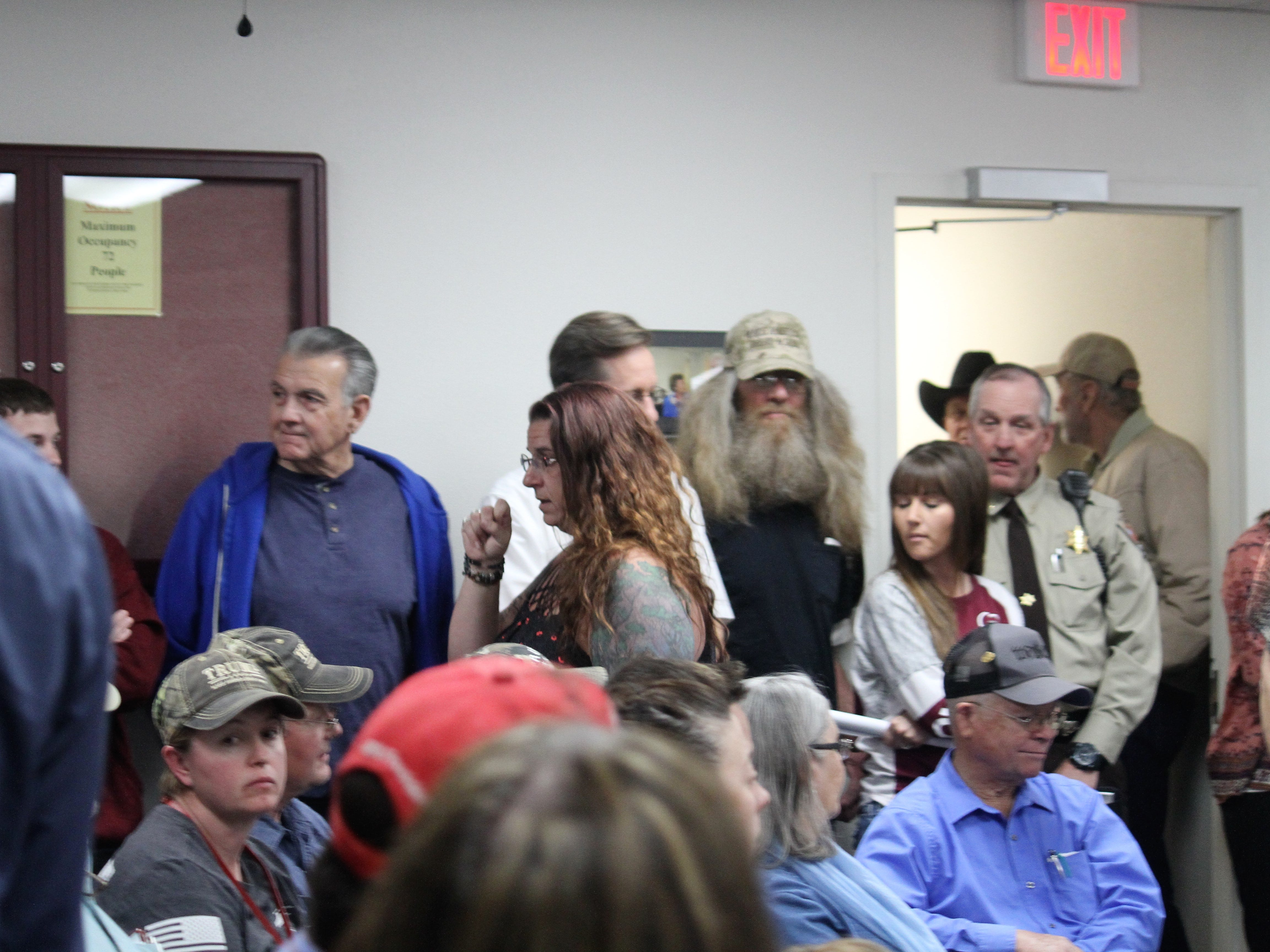 Lori Bies among the crowd headed to the Flickinger Center for the Performing Arts from the Otero County Commission Chambers Monday night. The Commission chambers were standing-room only with people lined up in the hallway outside.