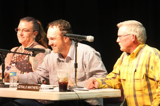 The Otero County Commission from left, Commissioner Lori Bies, Commission Chairman Couy Griffin and Commissioner Gerald Matherly on stage at the Flickinger Center Monday night. The commission held a special meeting to declare the county a Second Amendment Sanctuary County.