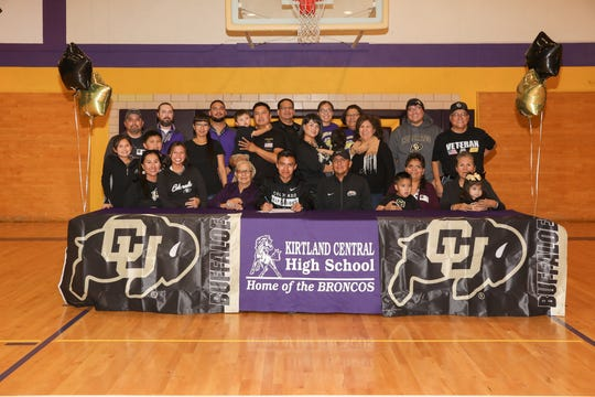 Kirtland Central's Kashon Harrison signs his national letter of intent on Monday to continue his cross country career at NCAA Division I University of Colorado.