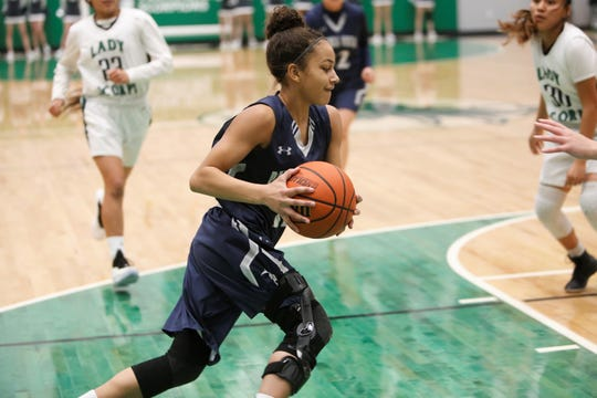 Piedra Vista's Elaina Watson drives to the basket against Farmington during Saturday's District 2-5A game at Scorpion Arena. PV is now No. 1 in the latest NMOTSC 5A girls basketball poll.