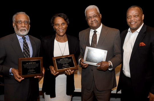 """Honored at the St. Landry Parish Black History Committee awards ceremony Sunday night were, from left,  Dr. Calvine White, Betty Mitchell,  Alvin """"Chubby"""" Haynes and Jerry Red, who provided introductions."""