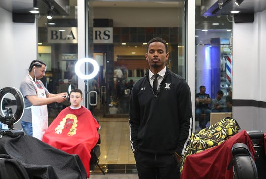 Palm Desert graduate and former NFL player James Dockery is the owner of Doc's Barbershop in the Westfield Palm Desert mall, February 25, 2019.