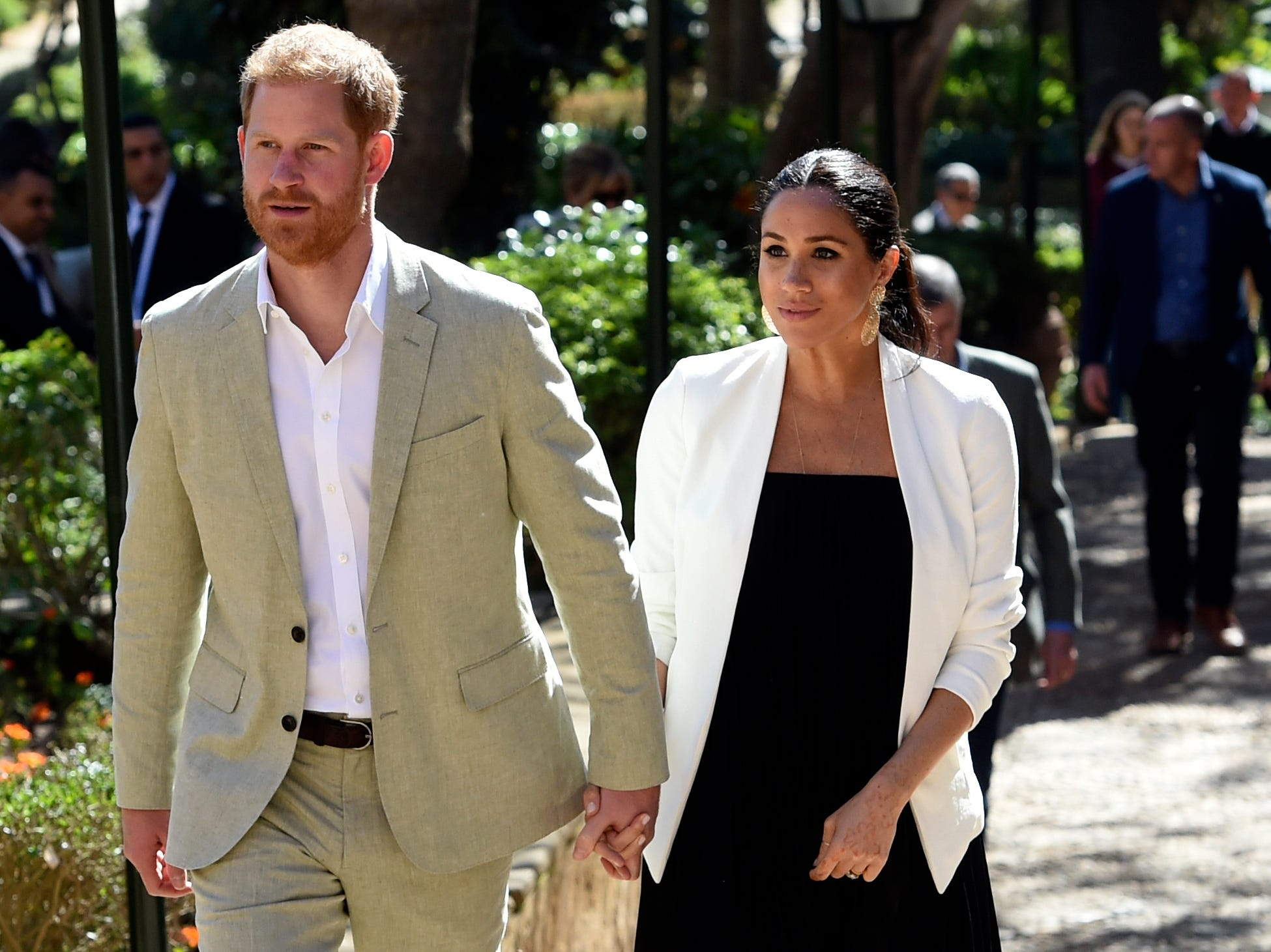 Britain's Prince Harry and Meghan, Duchess of Sussex visit the Andalusian Gardens in Rabat, Morocco, Monday, Feb. 25, 2019. The Duke and Duchess of Sussex are on a three day visit to the country.