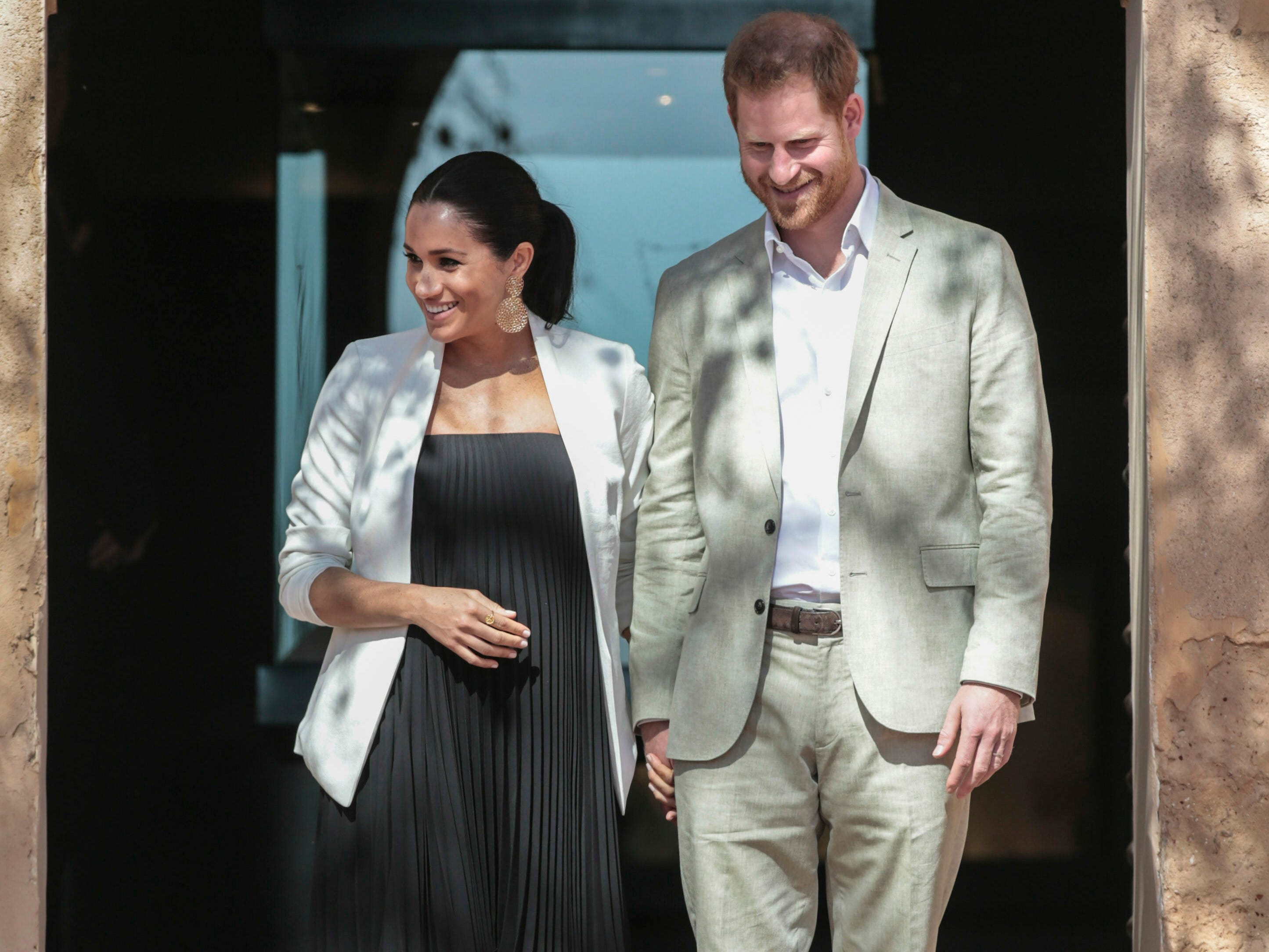 Britain's Prince Harry and Meghan, Duchess of Sussex visit a Social Entrepreneurs event and market in Rabat in Morocco, Monday, Feb. 25, 2019. The Duke and Duchess of Sussex are on a three day visit to the country.