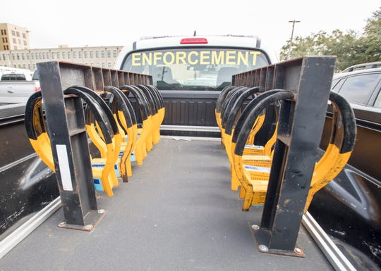 Admiral Enforcement equipment sits ready to boot vehicles at the privately-owned public-accessible parking lot still operated by Premium Parking along South Baylen Street in downtown Pensacola.