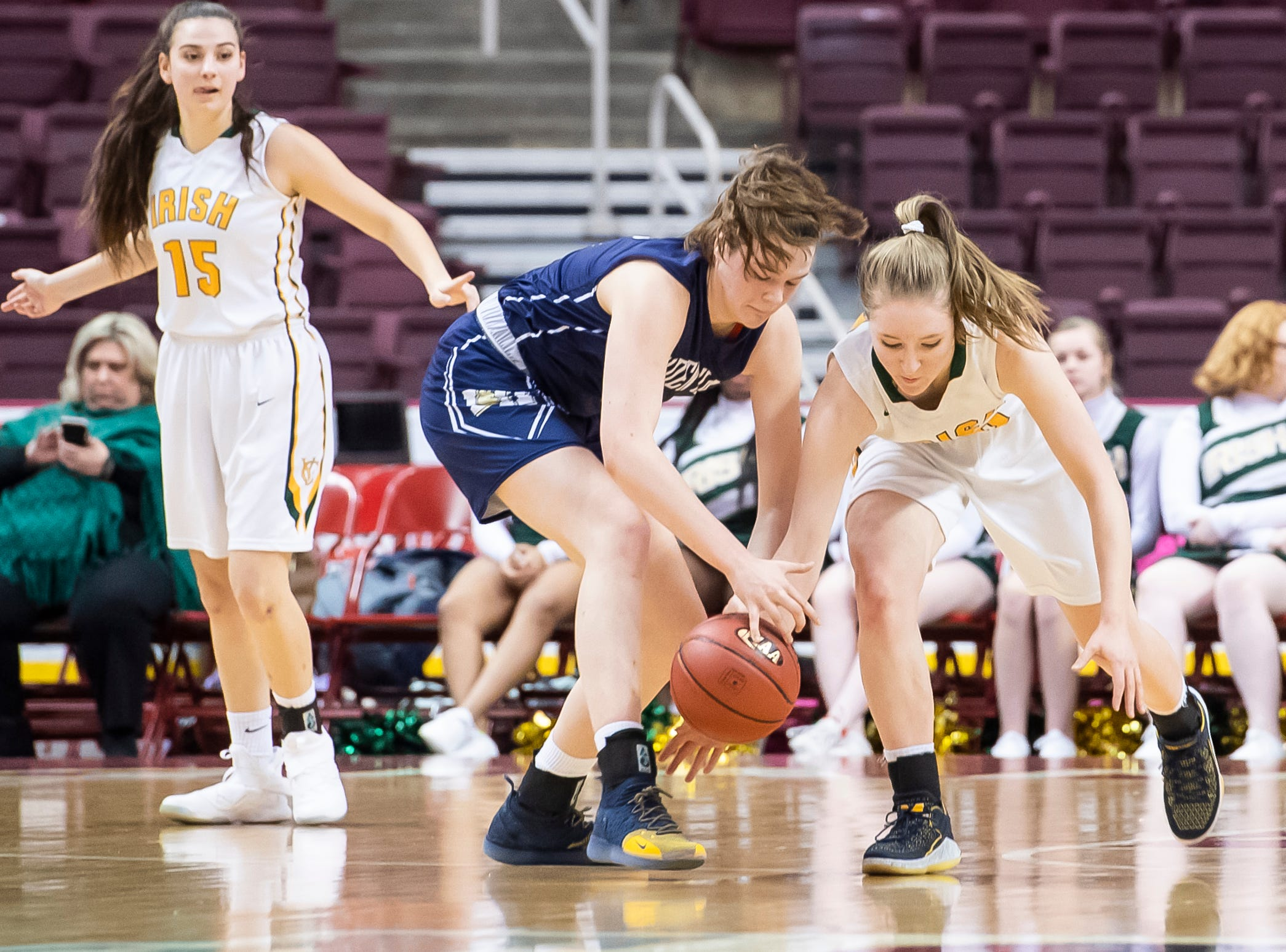 York Catholic's Katy Rader, right, makes a steal on Linden Hall's Hetta Saatman during the District 3 2-A girls championship game at the Giant Center in Hershey Tuesday, Feb. 26, 2019. The Fighting Irish fell 56-27.