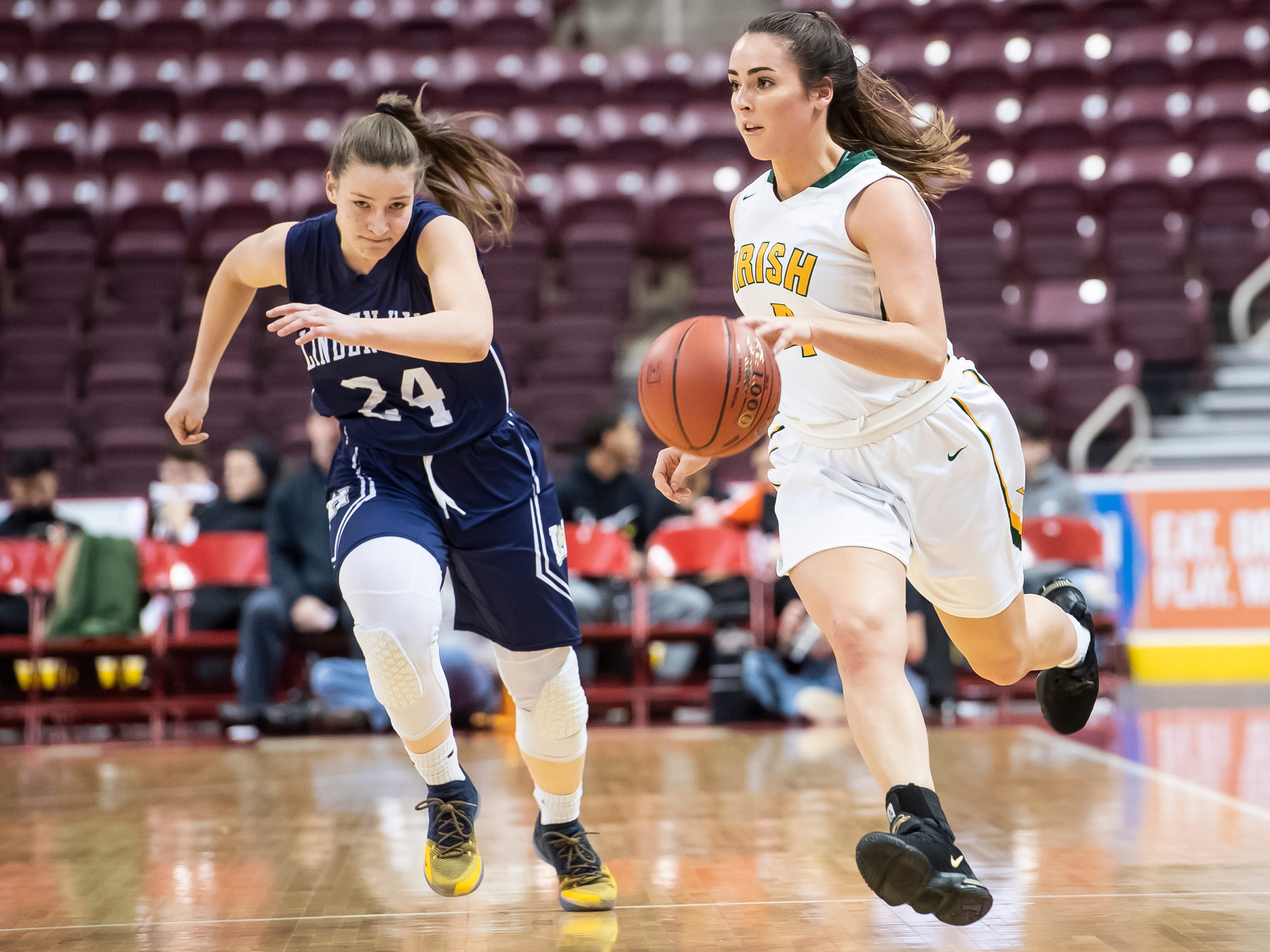 York Catholic's Gina Citrone drives down the court during the District 3 2-A girls championship game against Linden Hall at the Giant Center in Hershey Tuesday, Feb. 26, 2019. The Fighting Irish fell 56-27.