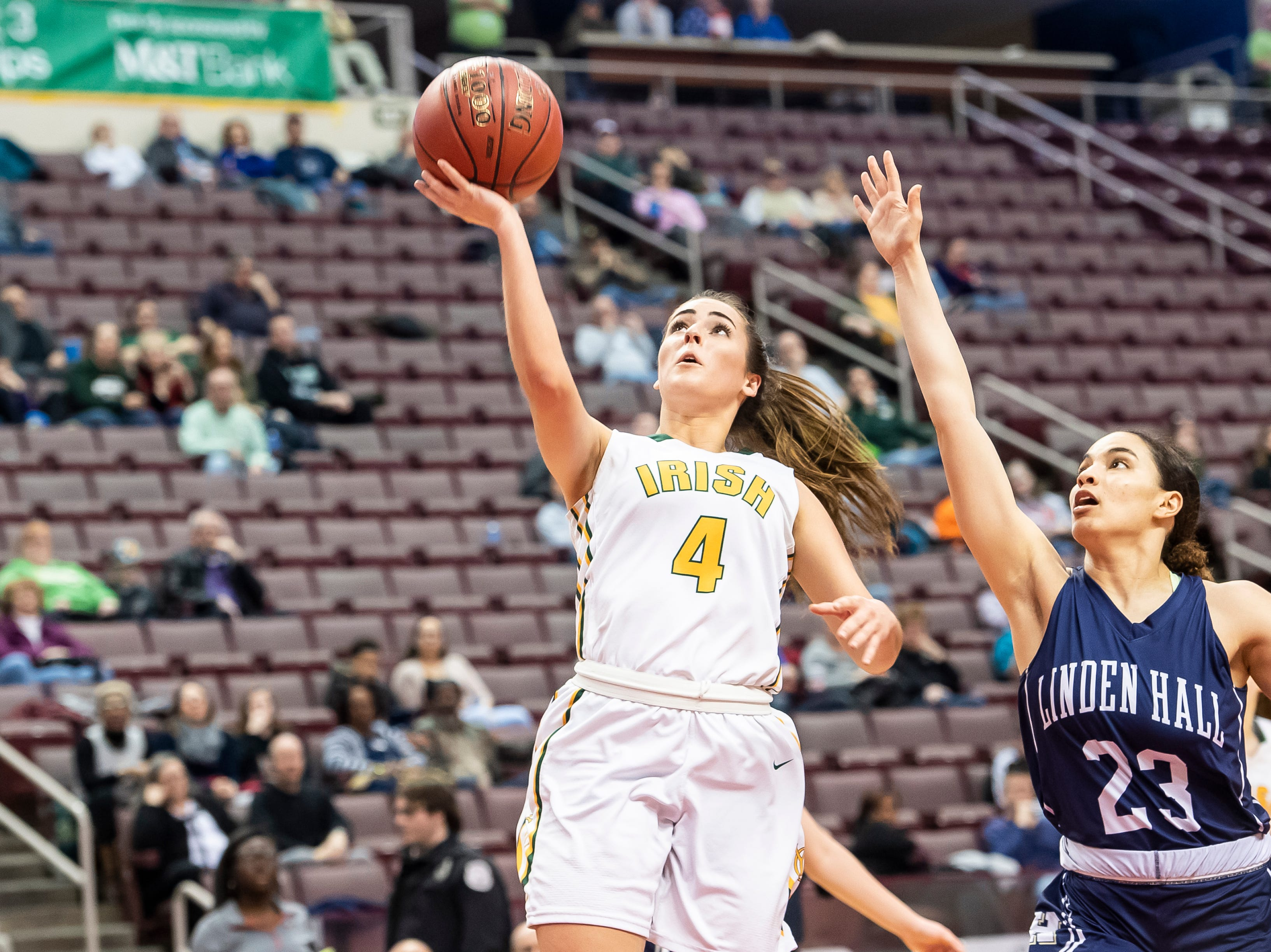 York Catholic's Gina Citrone shoots and scores on a layup during the District 3 2-A girls championship game against Linden Hall at the Giant Center in Hershey Tuesday, Feb. 26, 2019. The Fighting Irish fell 56-27.