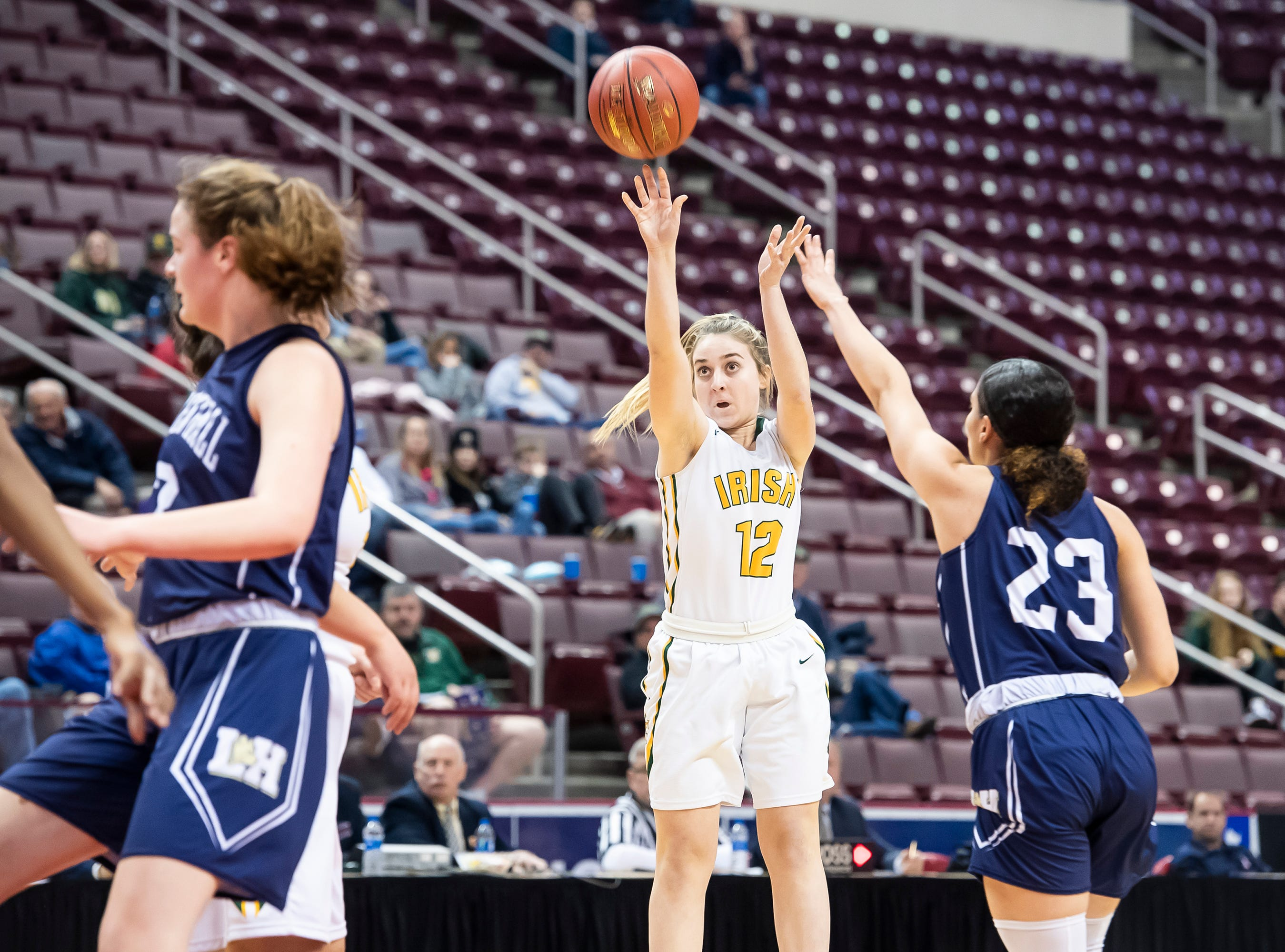 York Catholic's Samantha Bulik lets loose on a 3-point shot during the District 3 2-A girls championship game against Linden Hall at the Giant Center in Hershey Tuesday, Feb. 26, 2019. The Fighting Irish fell 56-27.