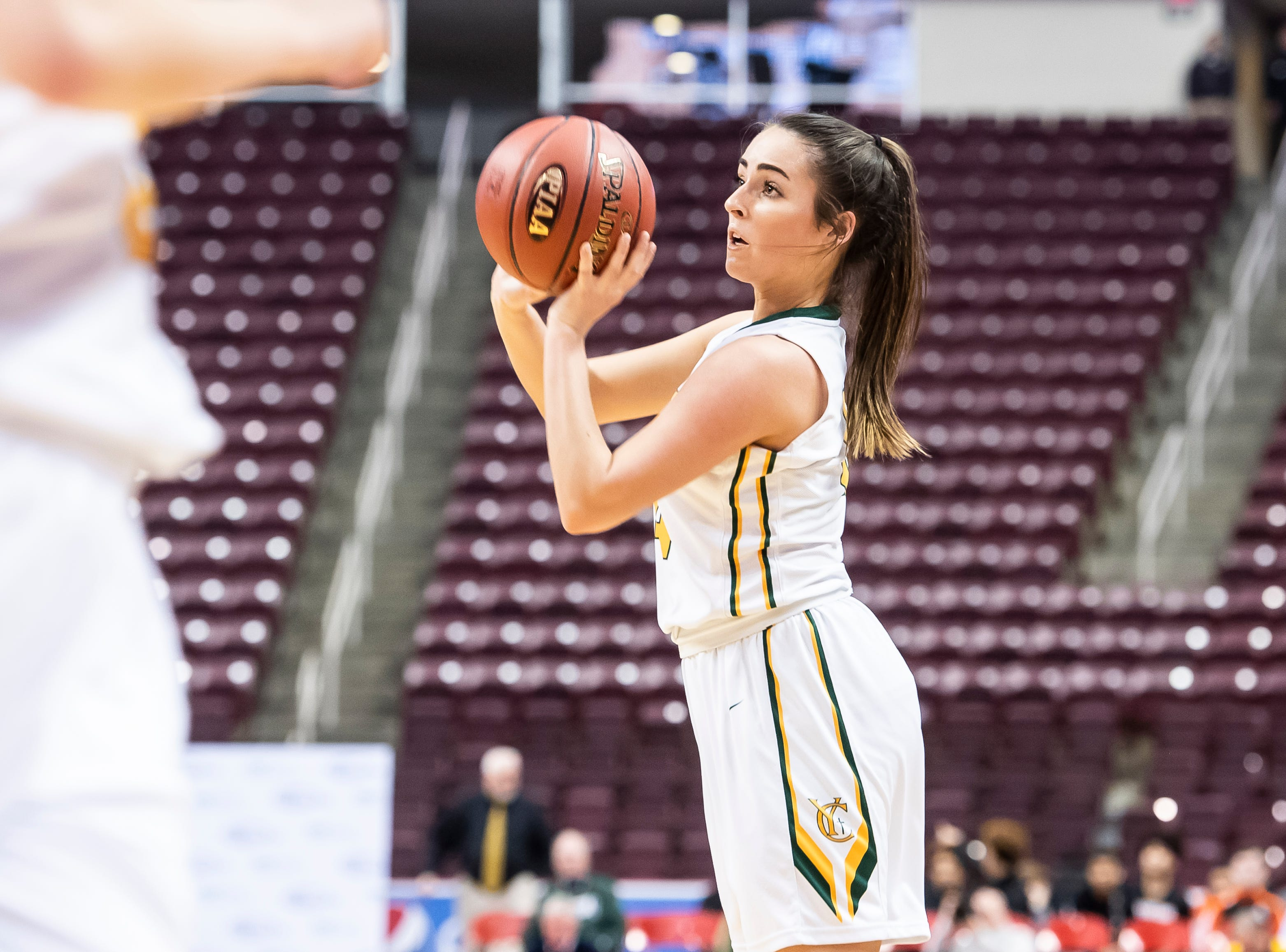 York Catholic's Gina Citrone pulls up on a jump shot during the District 3 2-A girls championship game against Linden Hall at the Giant Center in Hershey Tuesday, Feb. 26, 2019. The Fighting Irish fell 56-27.