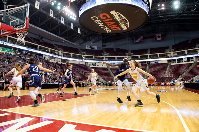 York Catholic's Katy Rader (30) dribbles around Linden Hall's Jumoke Adaramoye during the District 3 2-A girls championship game at the Giant Center in Hershey Tuesday, Feb. 26, 2019. The Fighting Irish fell 56-27.