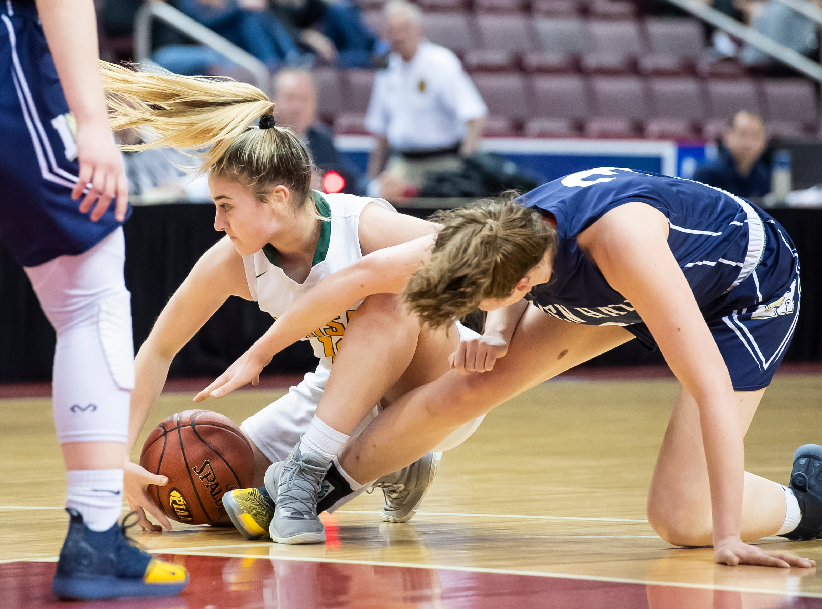 York Catholic's Samantha Bulik holds onto a loose ball during the District 3 2-A girls championship game against Linden Hall at the Giant Center in Hershey Tuesday, Feb. 26, 2019. The Fighting Irish fell 56-27.