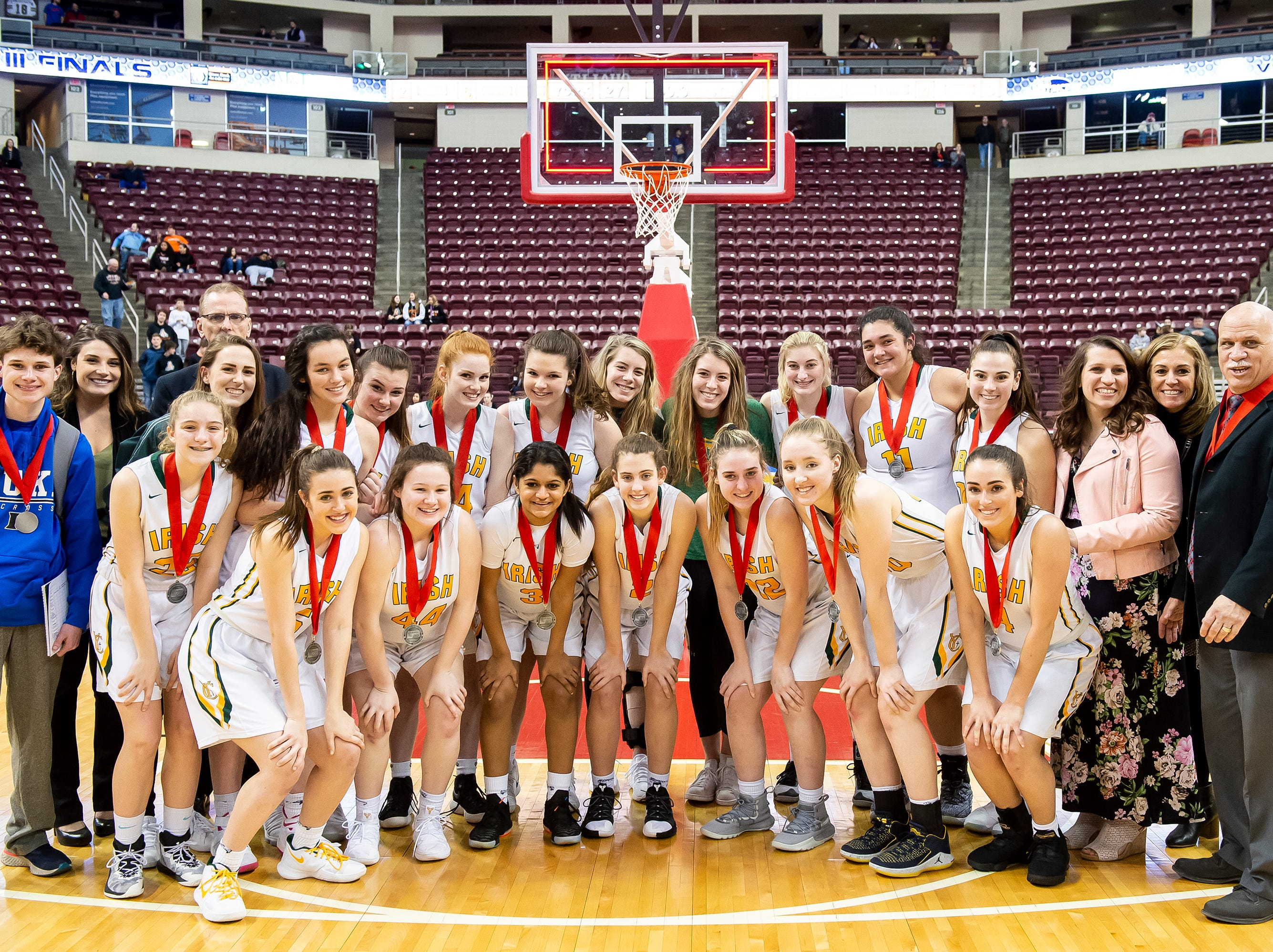 The 2018-2019 York Catholic girls basketball team pose for a photo after the District 3 2-A girls championship game at the Giant Center in Hershey Tuesday, Feb. 26, 2019. The Fighting Irish fell to Linden Hall 56-27.