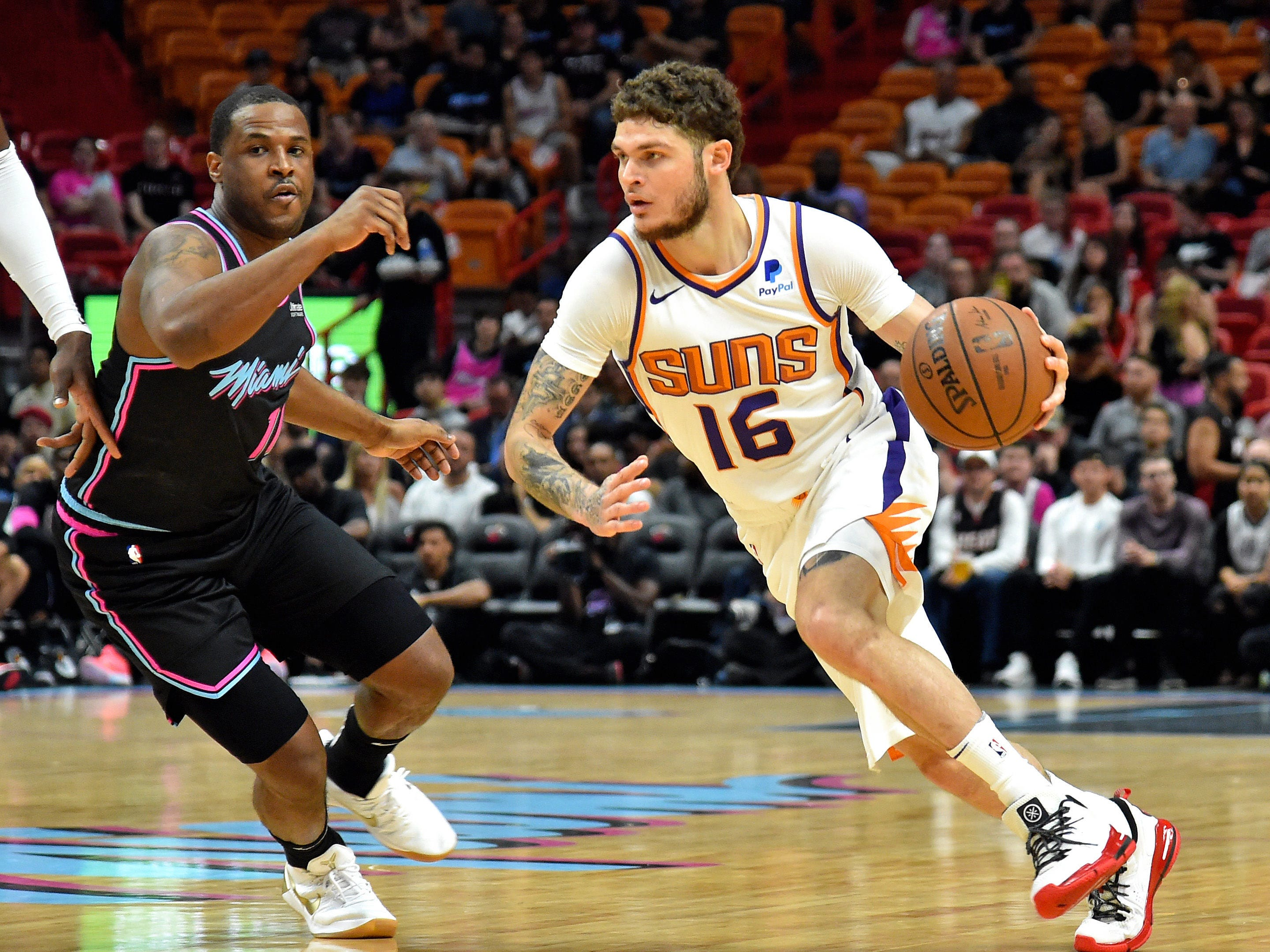 Feb 25, 2019; Miami, FL, USA; Phoenix Suns guard Tyler Johnson (16) is guarded by Miami Heat guard Dion Waiters (11) during the first half at American Airlines Arena. Mandatory Credit: Steve Mitchell-USA TODAY Sports