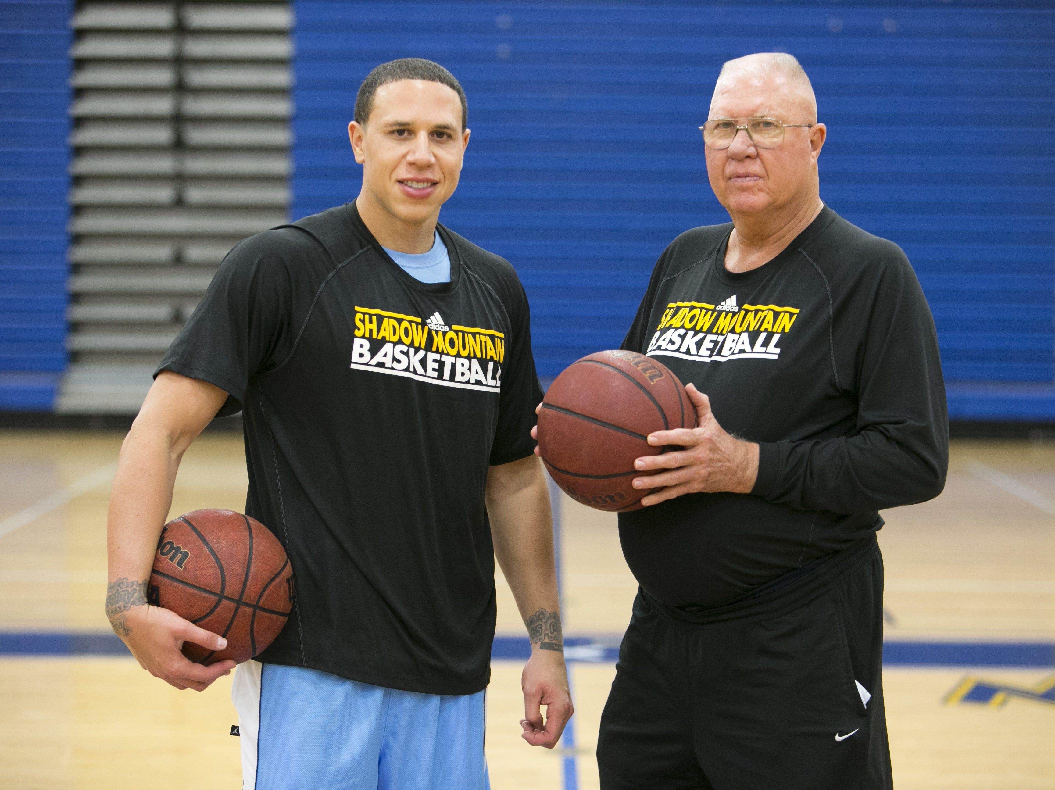 Former Shadow Mountain and UA star and NBA player and now Shadow Mountain assistant coach Mike Bibby is seen with Shadow Mountain head coach Jerry Conner during a practice at Shadow Mountain High in Phoenix on Wednesday, December 11, 2013.