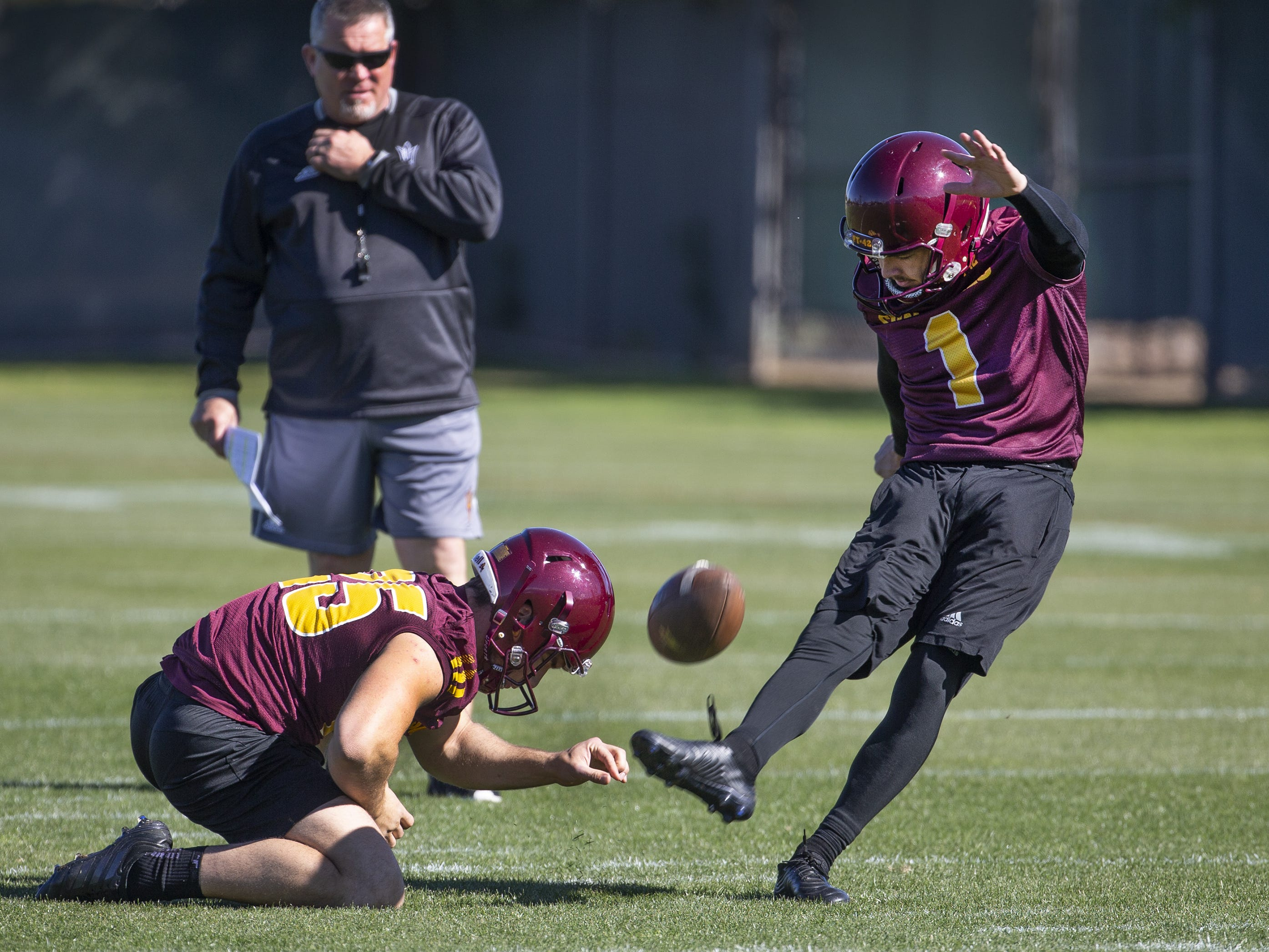 The Arizona State University football team practiced in Tempe, Tuesday, February 26, 2019.   Kicker Brandon Ruiz aims for the goalposts during practice.