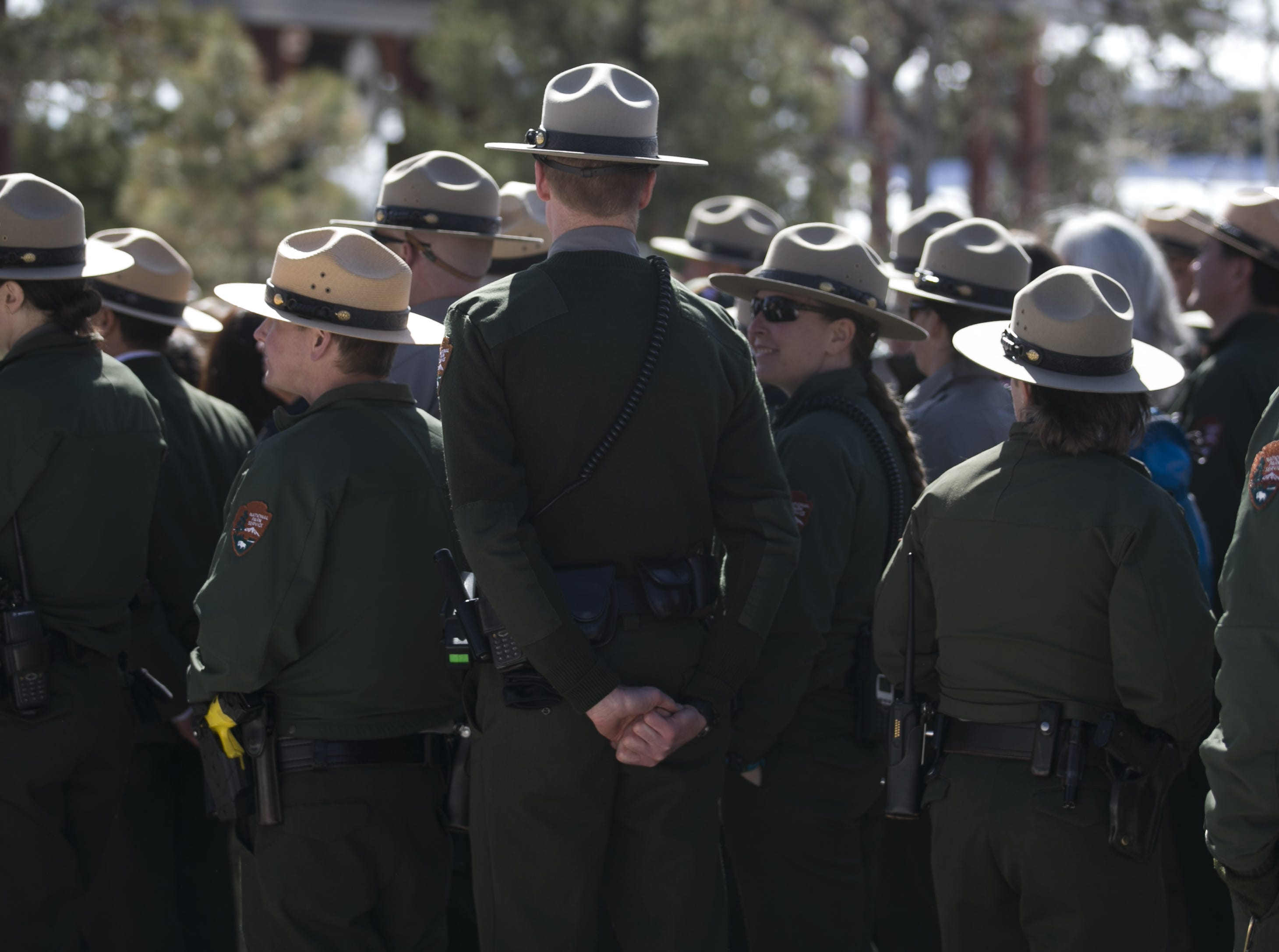 Park rangers stand for a group photo at the Grand Canyon during the park's 100th anniversary on Feb. 26, 2019.