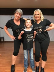 Friends in Dance made 9-year-old Isabella McCune an honorary member with an official T-shirt.