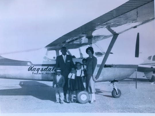 Civil Rights pioneer and Tuskegee Airman, Lincoln Ragsdale Sr. stands with his family and the Censsna 152 he purchased.