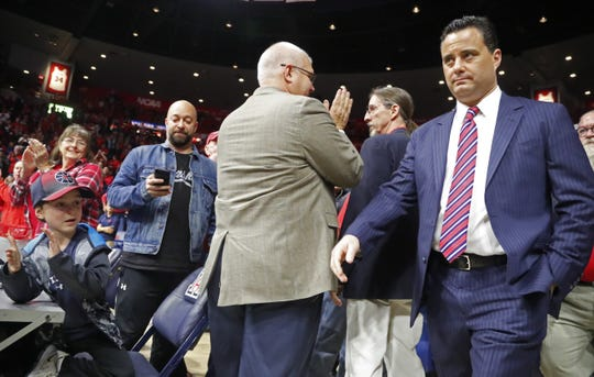 Arizona's head coach Sean Miller enters the court before a game against Stanford at the McKale Center on March 1, 2018.