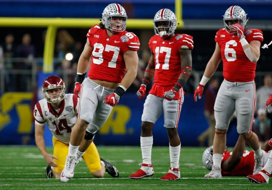 Ohio State defensive lineman Nick Bosa (97) celebrates after sacking USC quarterback Sam Darnold during the the first quarter of the 2017 Cotton Bowl at AT&T Stadium.