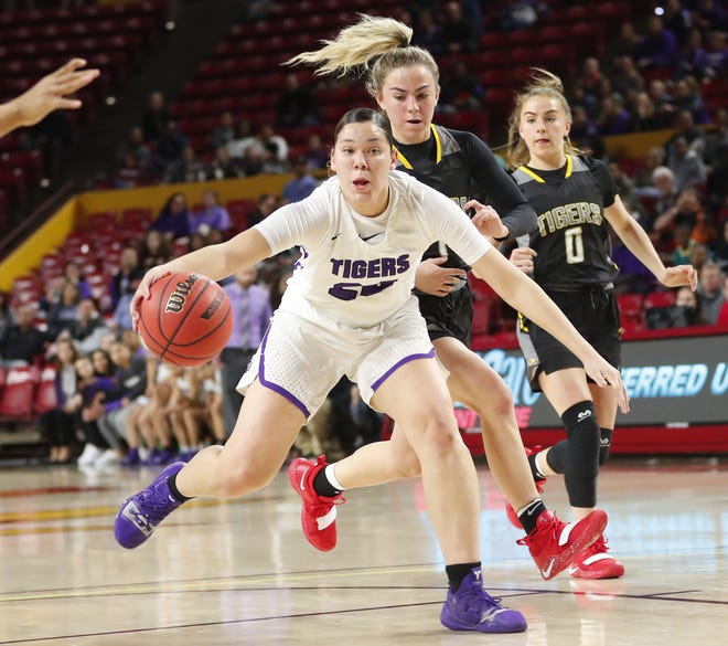 Millennium's Dominique Phillips (24) is pressured by Gilbert's Haley Cavinder (1) during the Girls State 5A Championship game in Tempe, Ariz. Feb. 25, 2019.