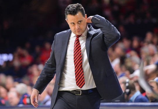 Arizona coach Sean Miller walks the sideline during the first half of a game against Washington State.