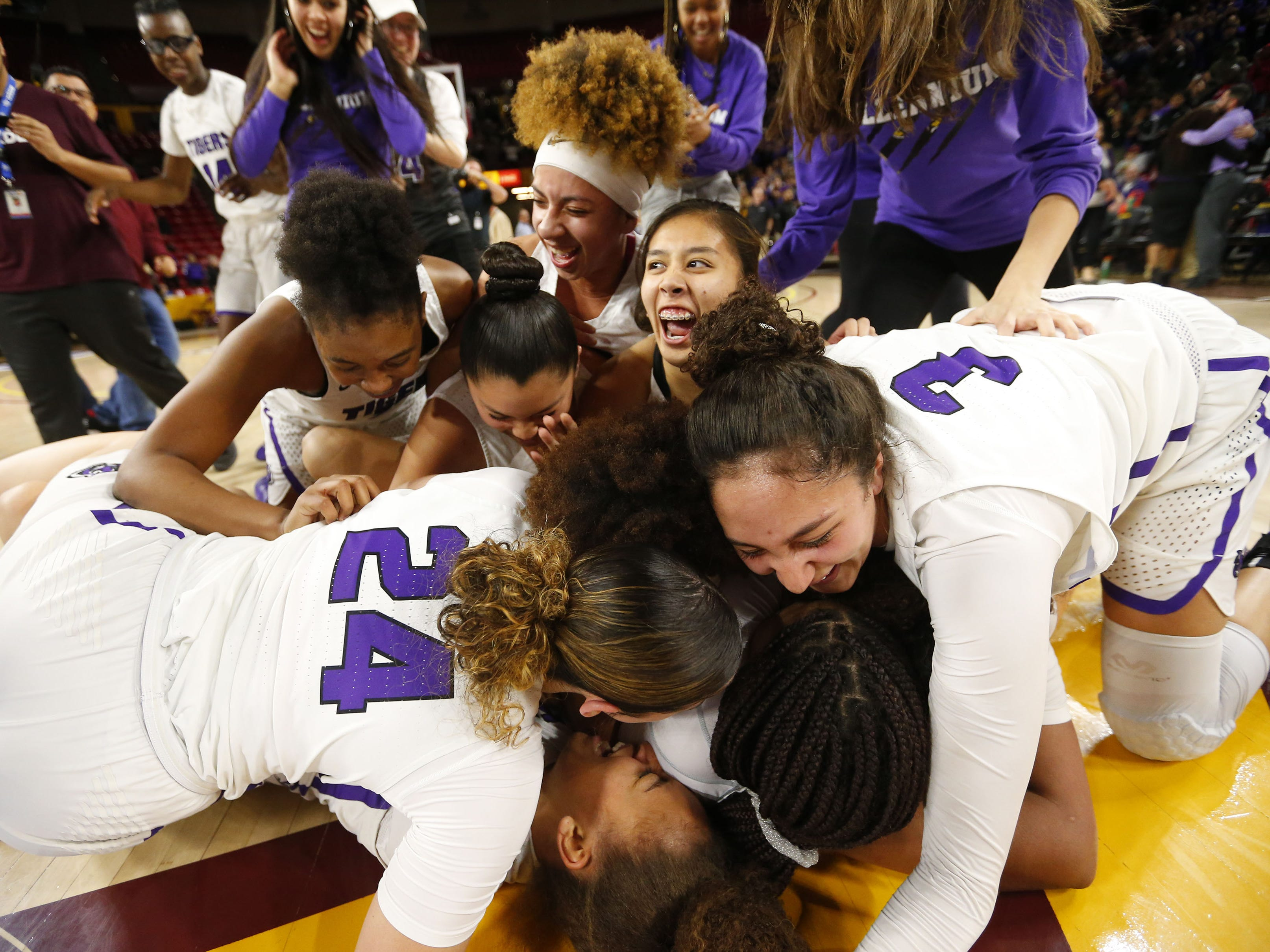Millennium players celebrate after winning the Girls State 5A Championship game against Gilbert in Tempe, Ariz. Feb. 25, 2019.