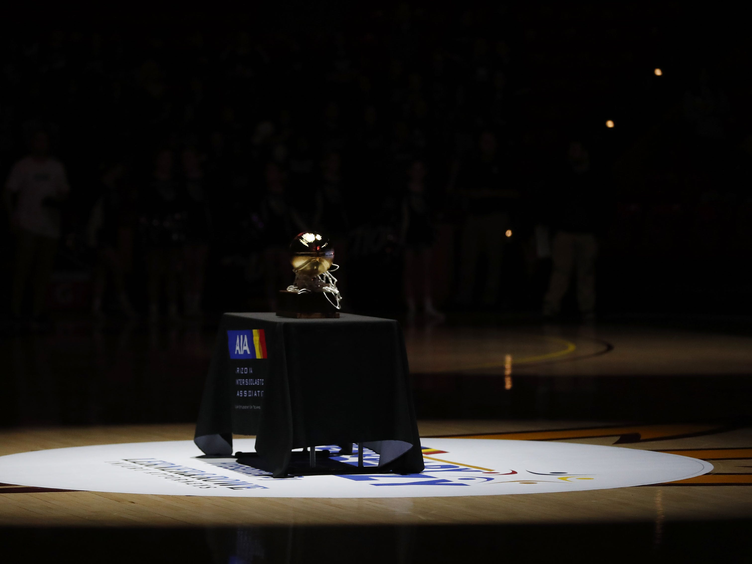 The Girls State 5A Championship trophy on display before a game between Millennium and Gilbert in Tempe, Ariz. Feb. 25, 2019.