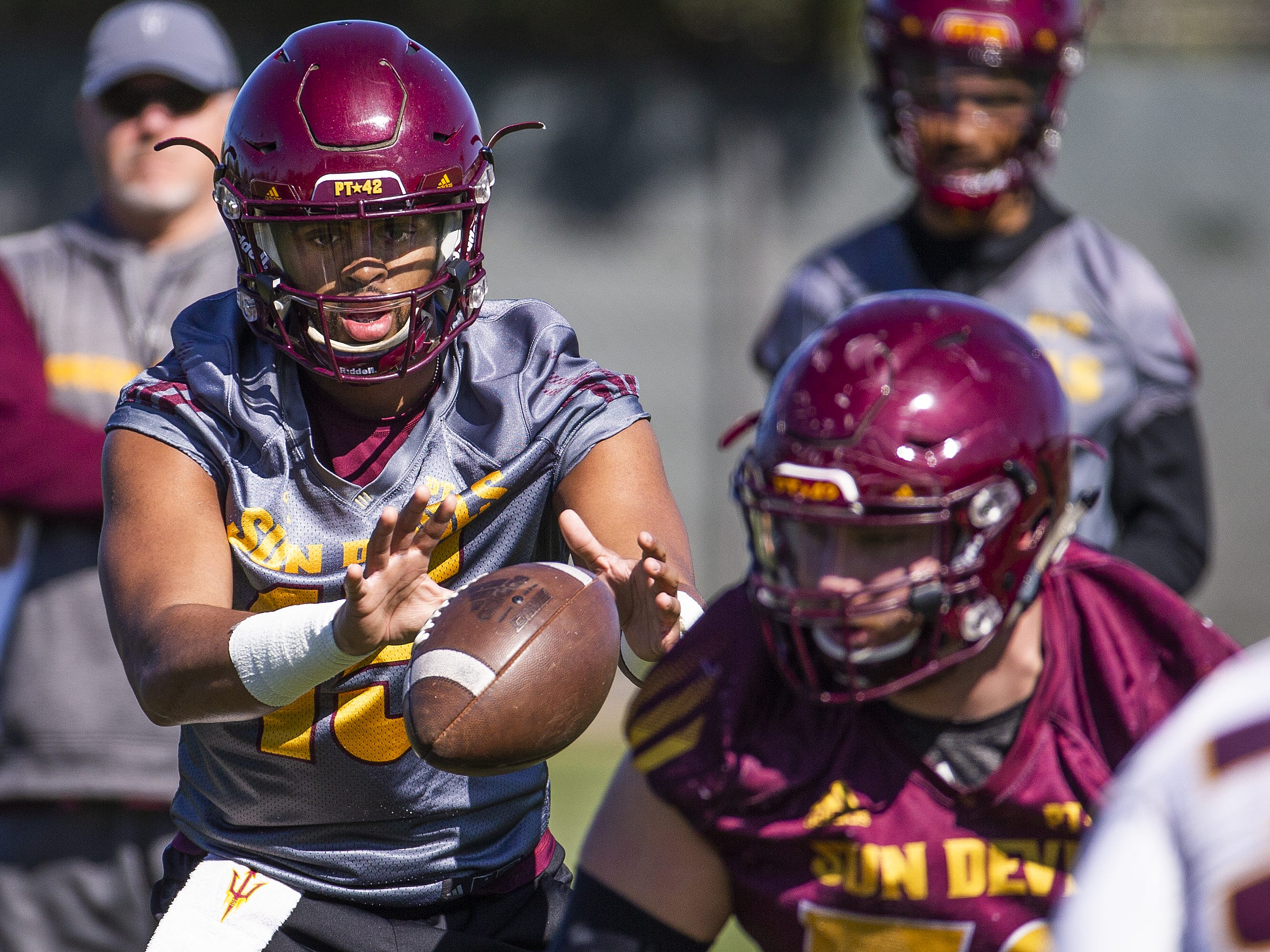 The Arizona State University football team practiced in Tempe, Tuesday, February 26, 2019.   Quarterback Dillon Sterling-Cole takes a snap.