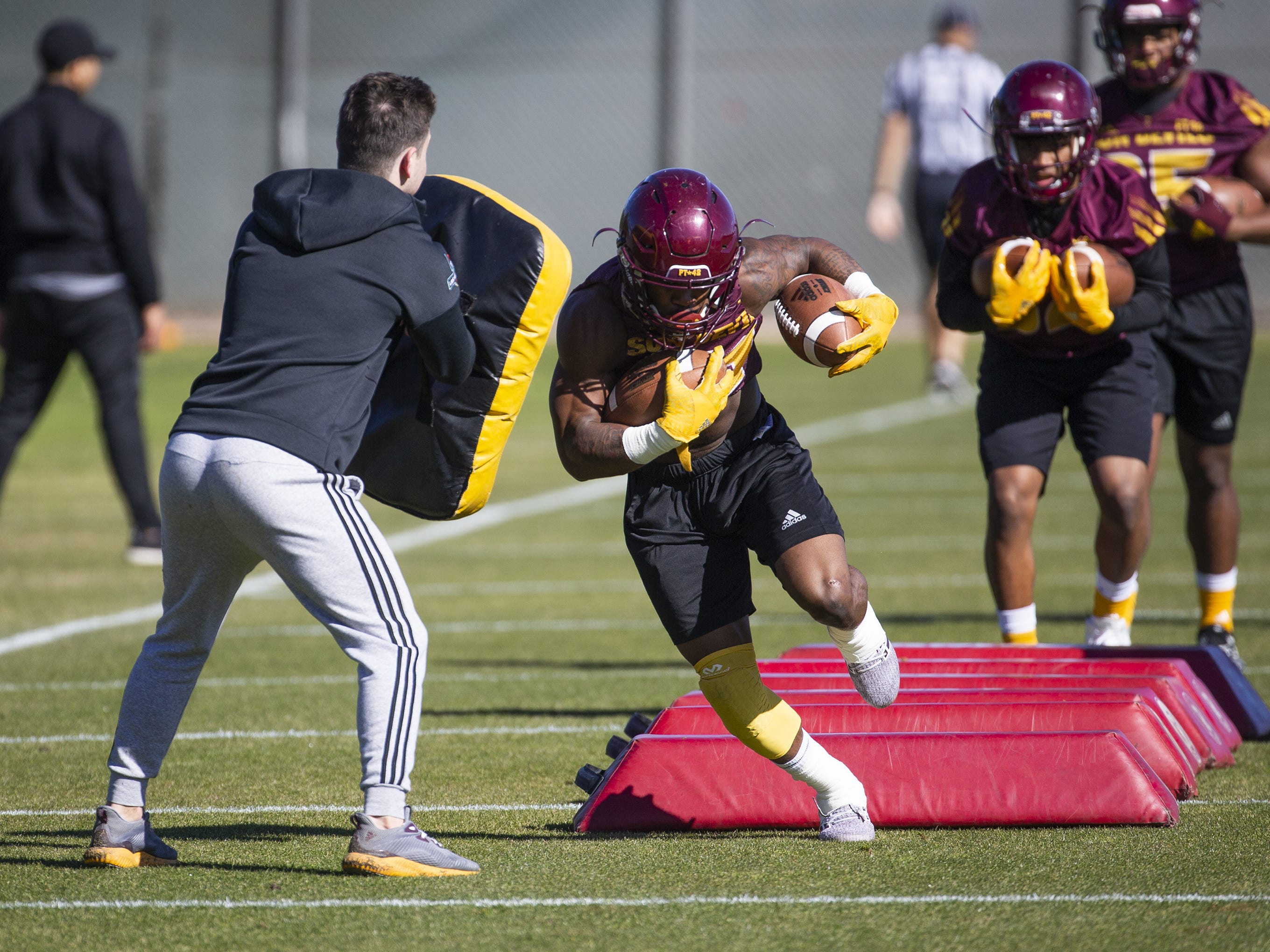The Arizona State University football team practiced in Tempe, Tuesday, February 26, 2019.   Running back Isaiah Floyd takes a hit during drills.