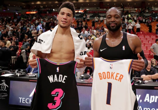 Devin Booker and Dwyane Wade exchange jerseys after a game on Feb. 25.