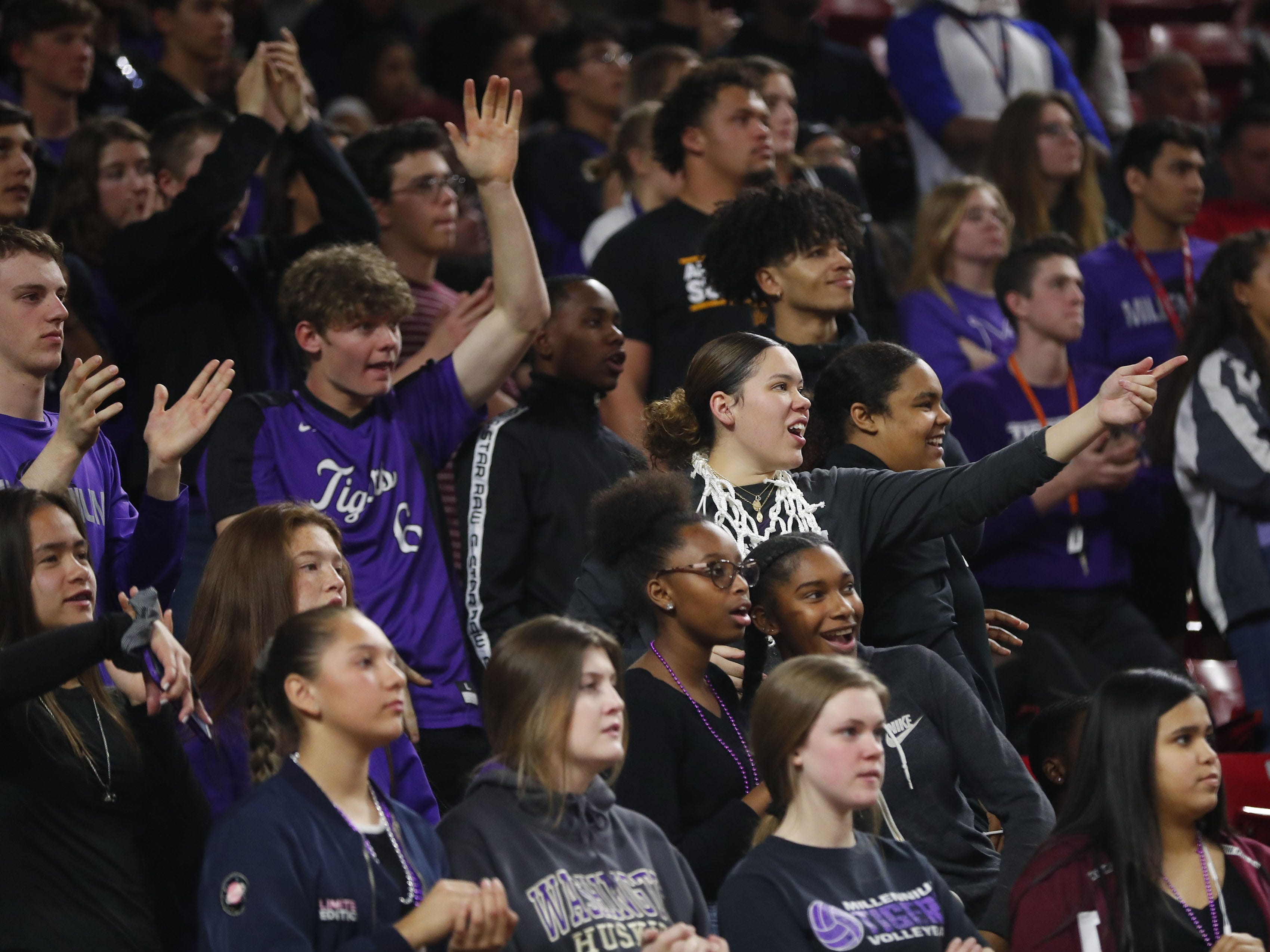 Millennium students cheer for their team against Gilbert during the Boys State 5A Championship game in Tempe, Ariz. Feb. 25, 2019.