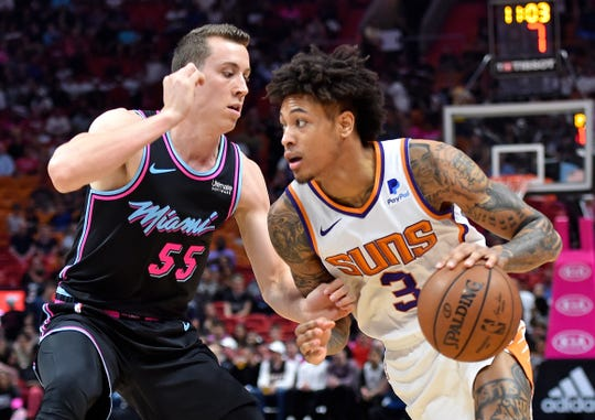 Feb 25, 2019; Miami, FL, USA; Phoenix Suns forward Kelly Oubre Jr. (3) dribbles the ball as Miami Heat forward Duncan Robinson (55) defends during the first half at American Airlines Arena. Mandatory Credit: Steve Mitchell-USA TODAY Sports