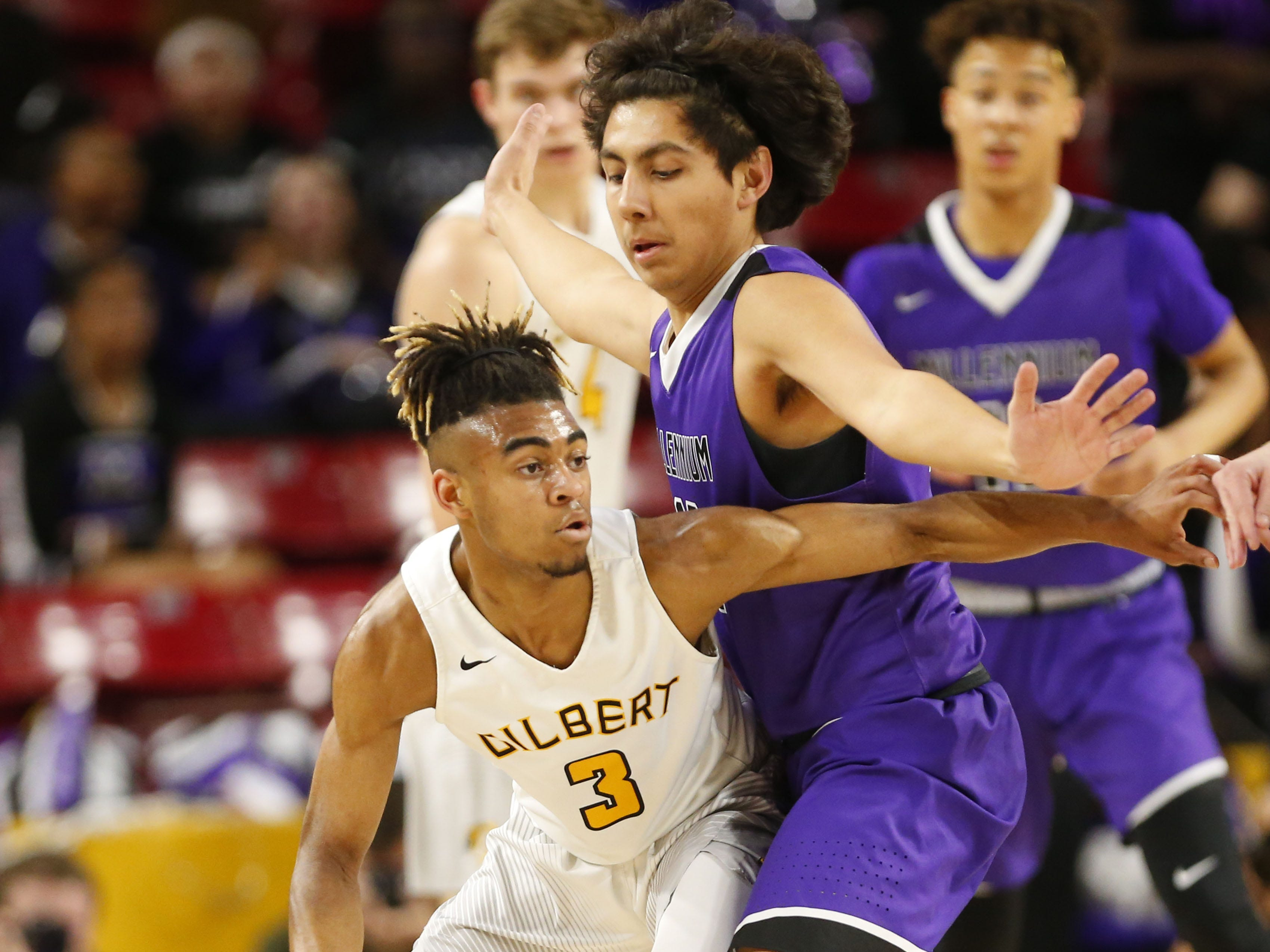 Gilbert's Doc Self (3) is pressured by Millennium's Jose Cortes (13) during the Boys State 5A Championship game in Tempe, Ariz. Feb. 25, 2019.